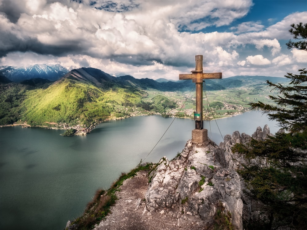 brown wooden cross on top of mountain