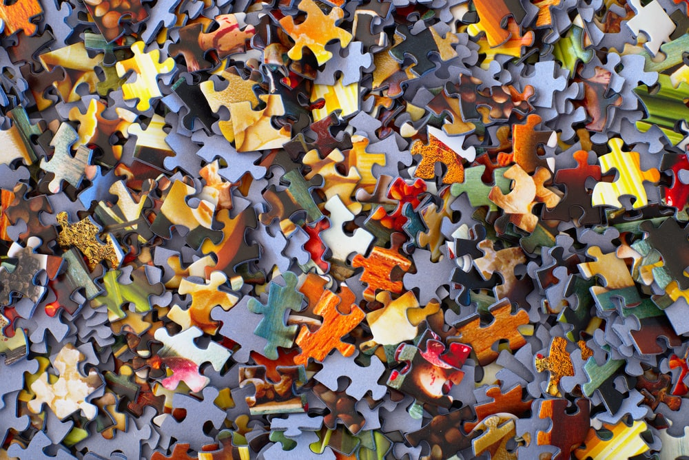 An aerial shot of brightly-colored jigsaw puzzle pieces