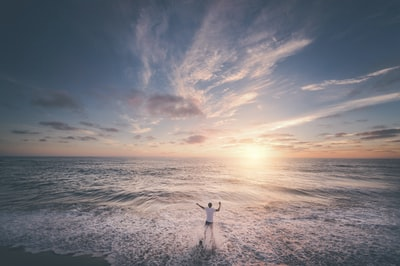 man standing on seashore during sunset tumblr teams background