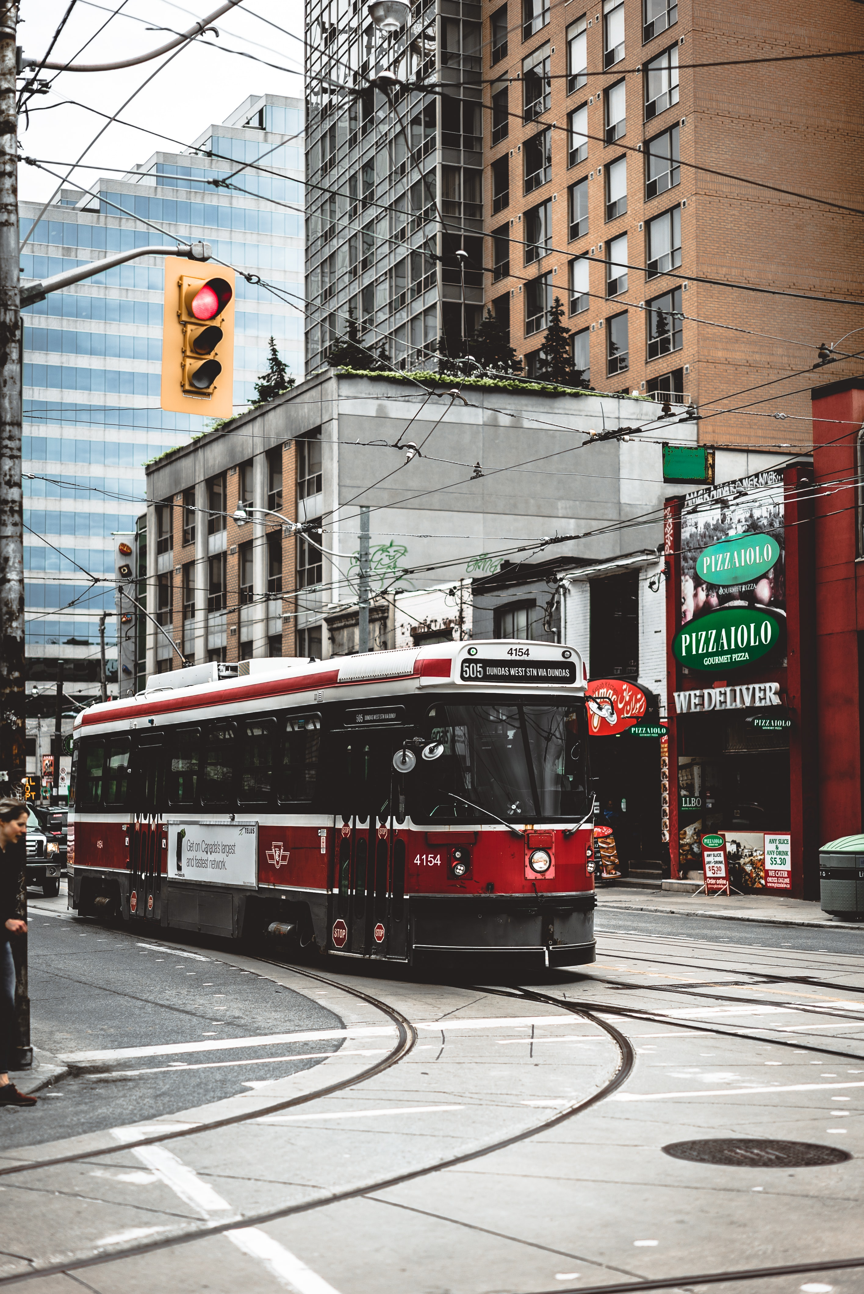 A red trolley car on the tracks in Toronto