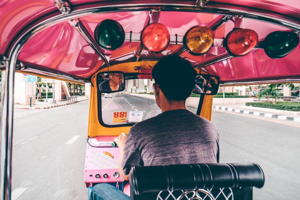 A man driving an auto rickshaw in Bangkok