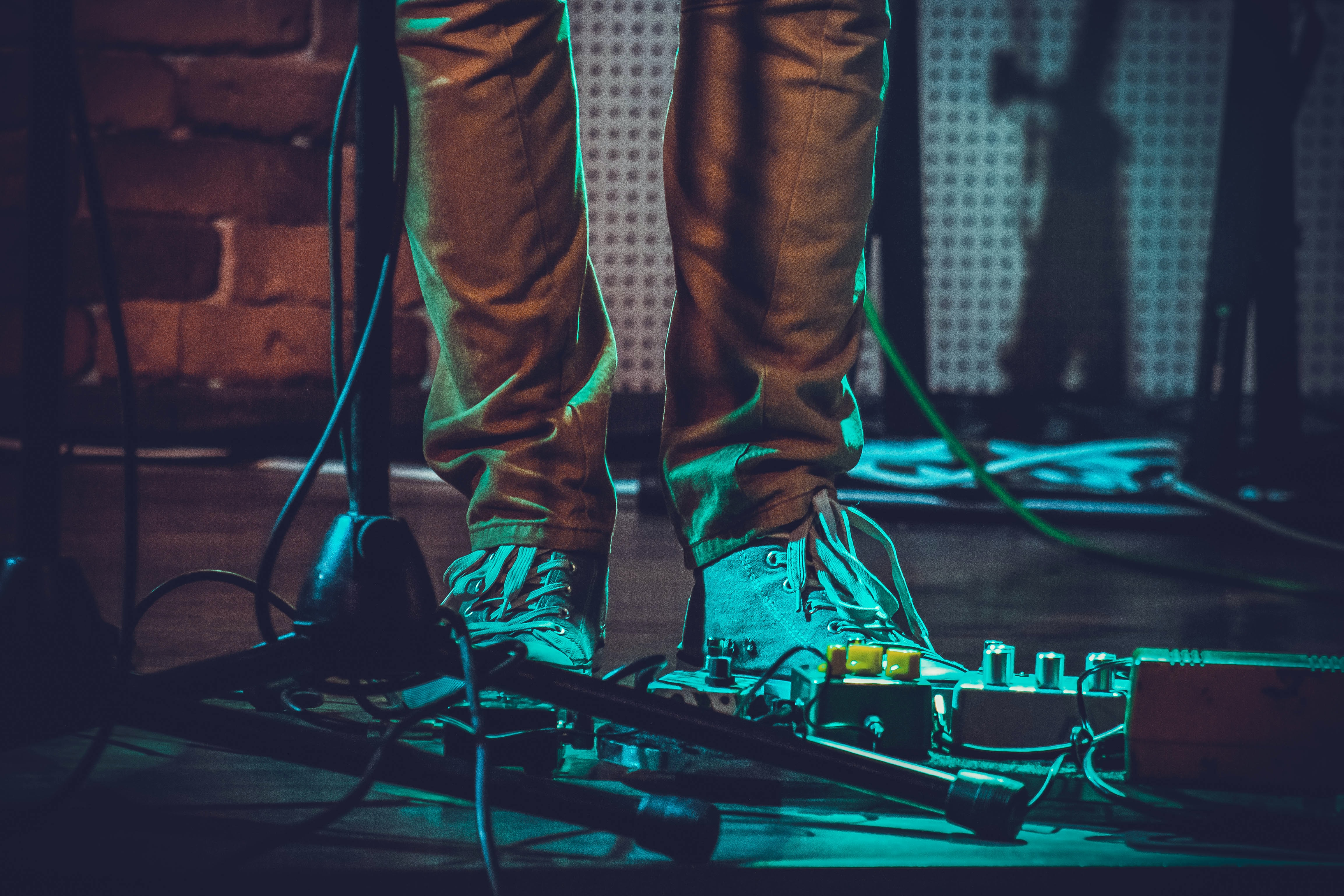 A low-shot of a musician's shoes and music equipment