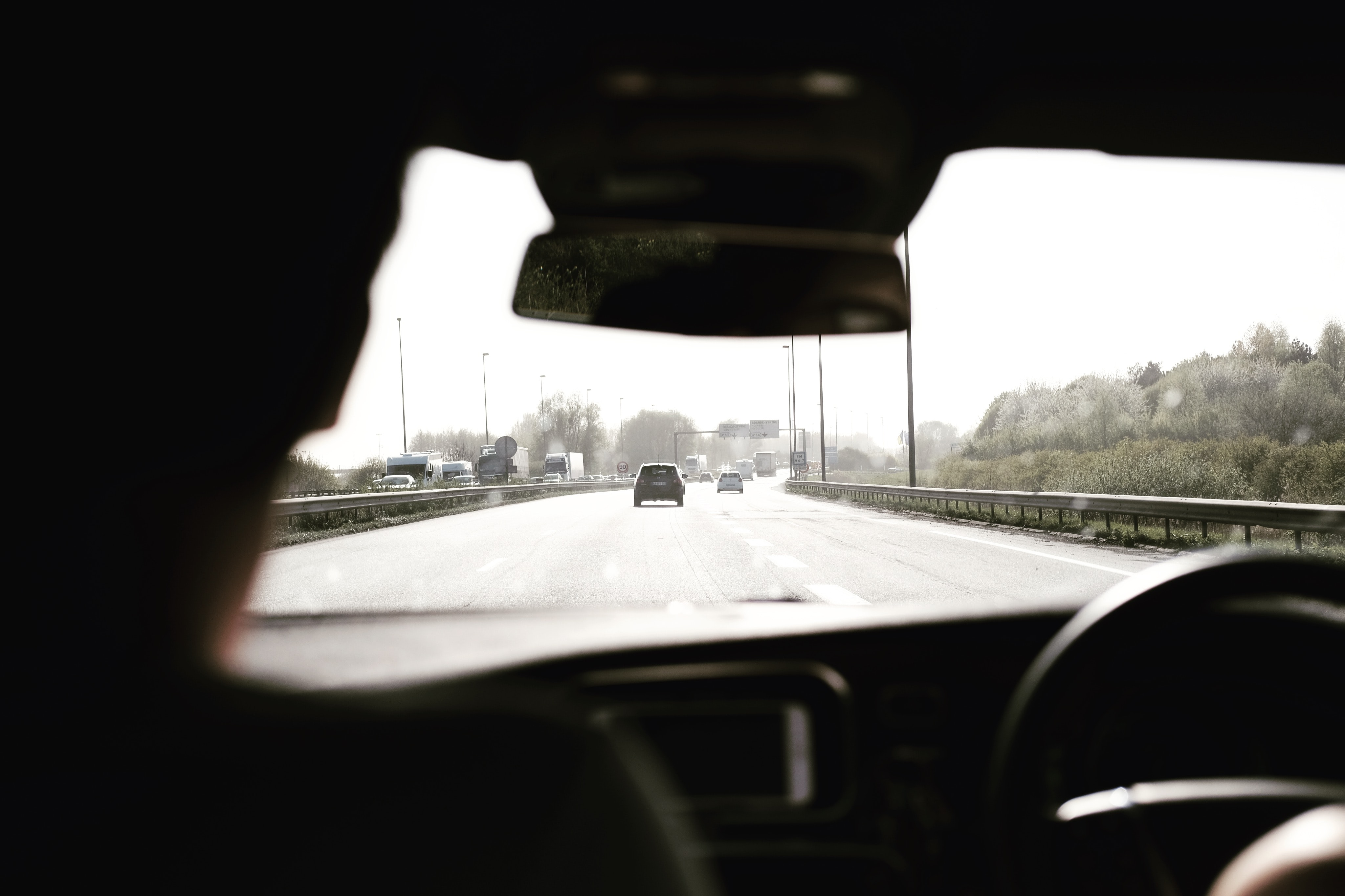A view from the backseat on a highway in De Haan