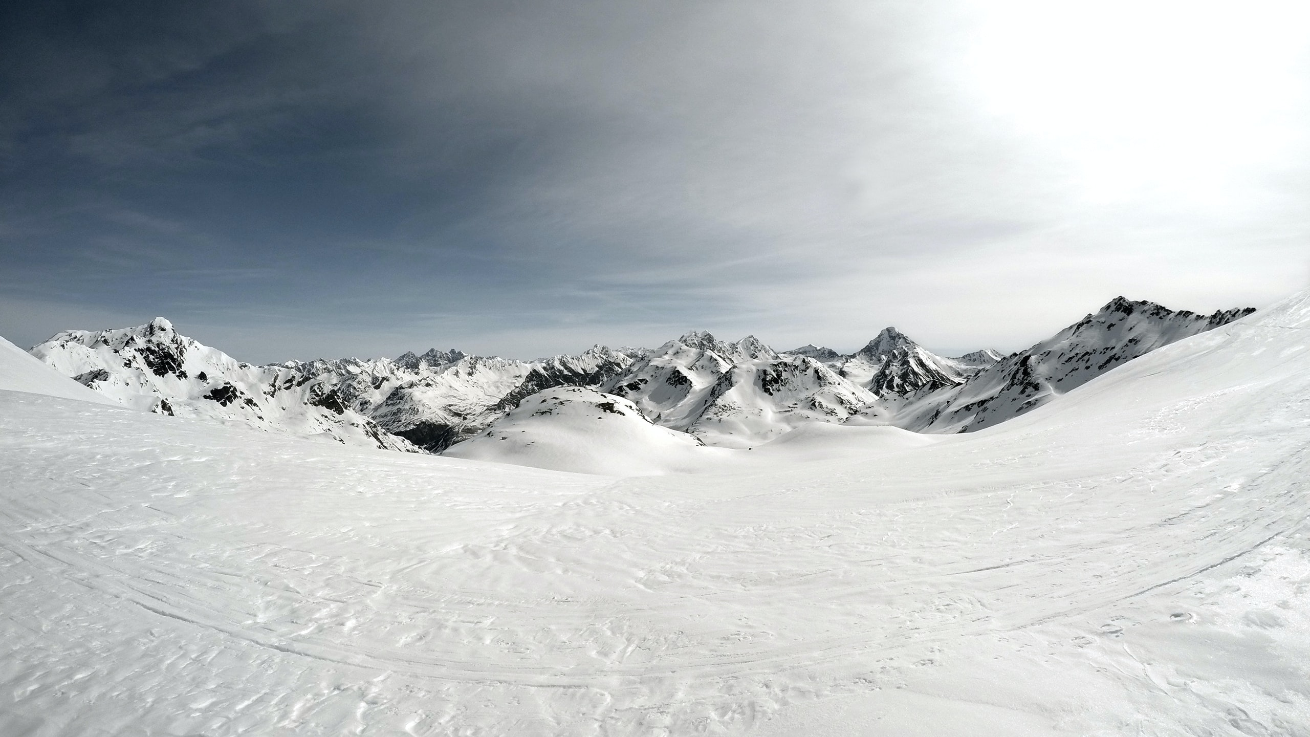 Fish eye snowy landscape of land and mountains on a sunny day at Flüela Wisshorn