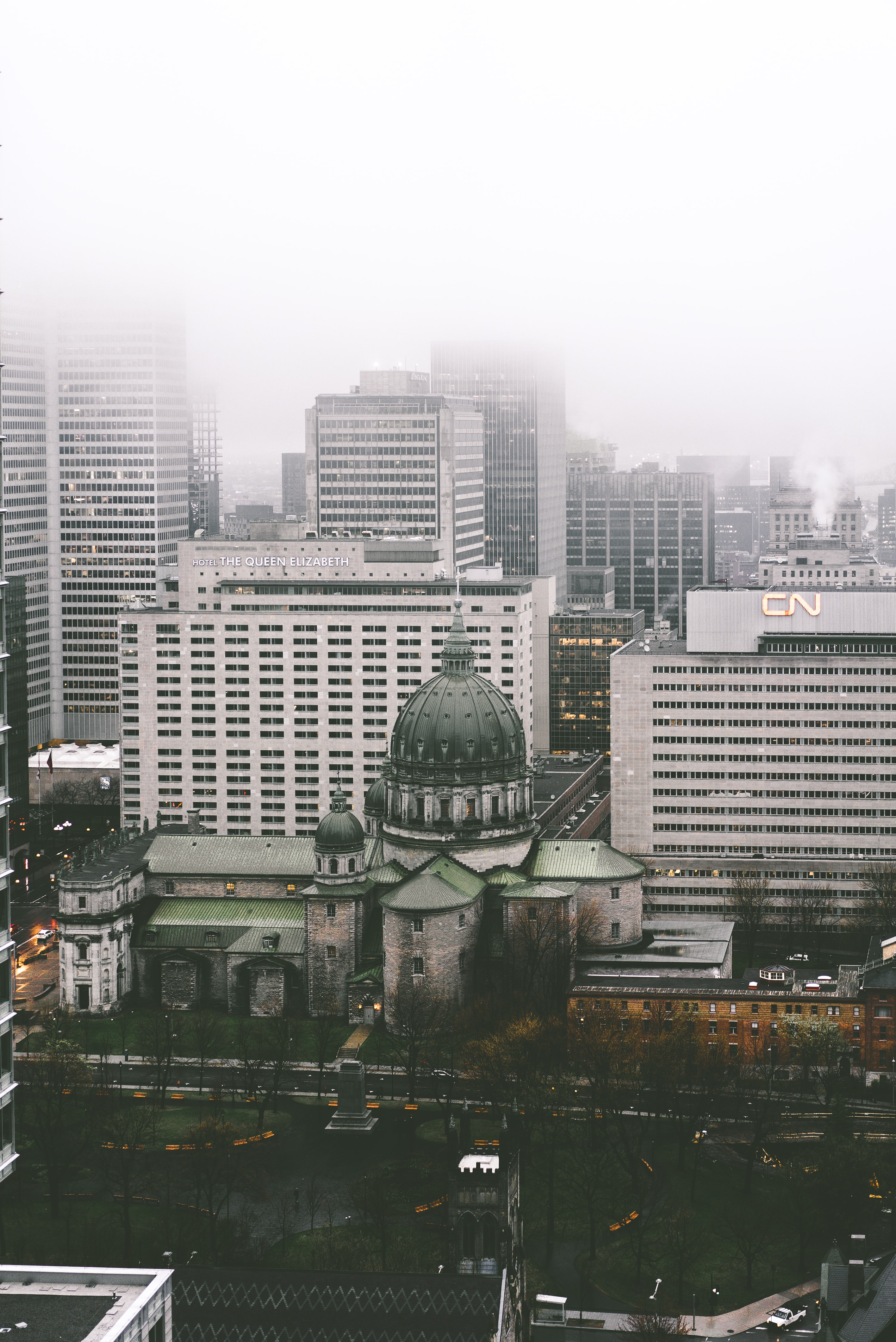 A church and high-rises in Montreal on a foggy day
