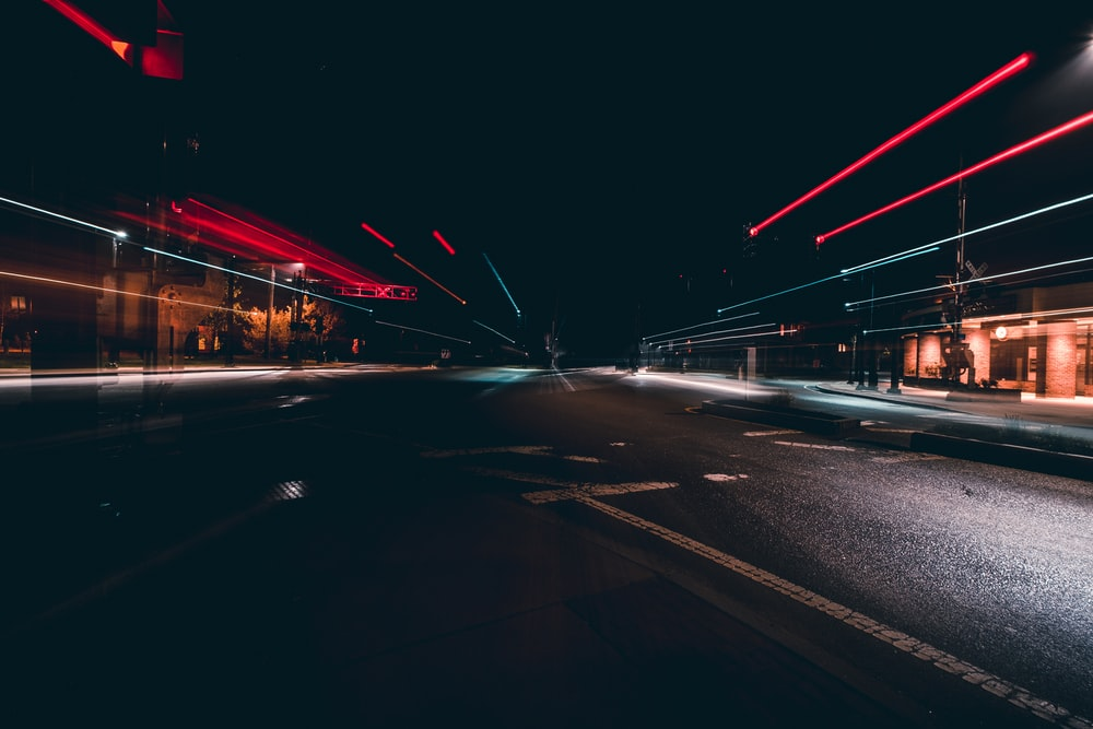 A Long Exposure Shot Of Dark Empty Road With Motion Trails