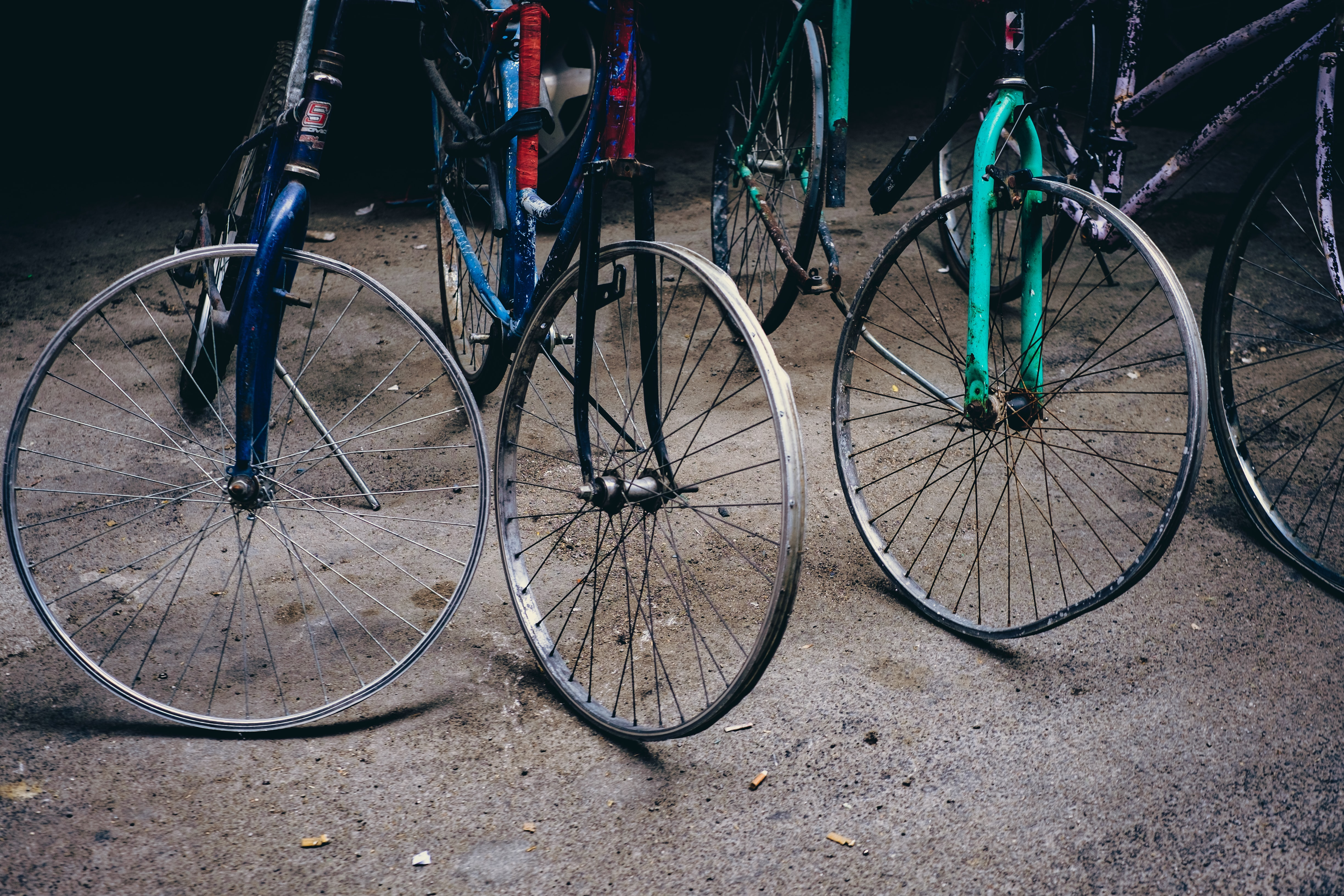 three bicycle without tires