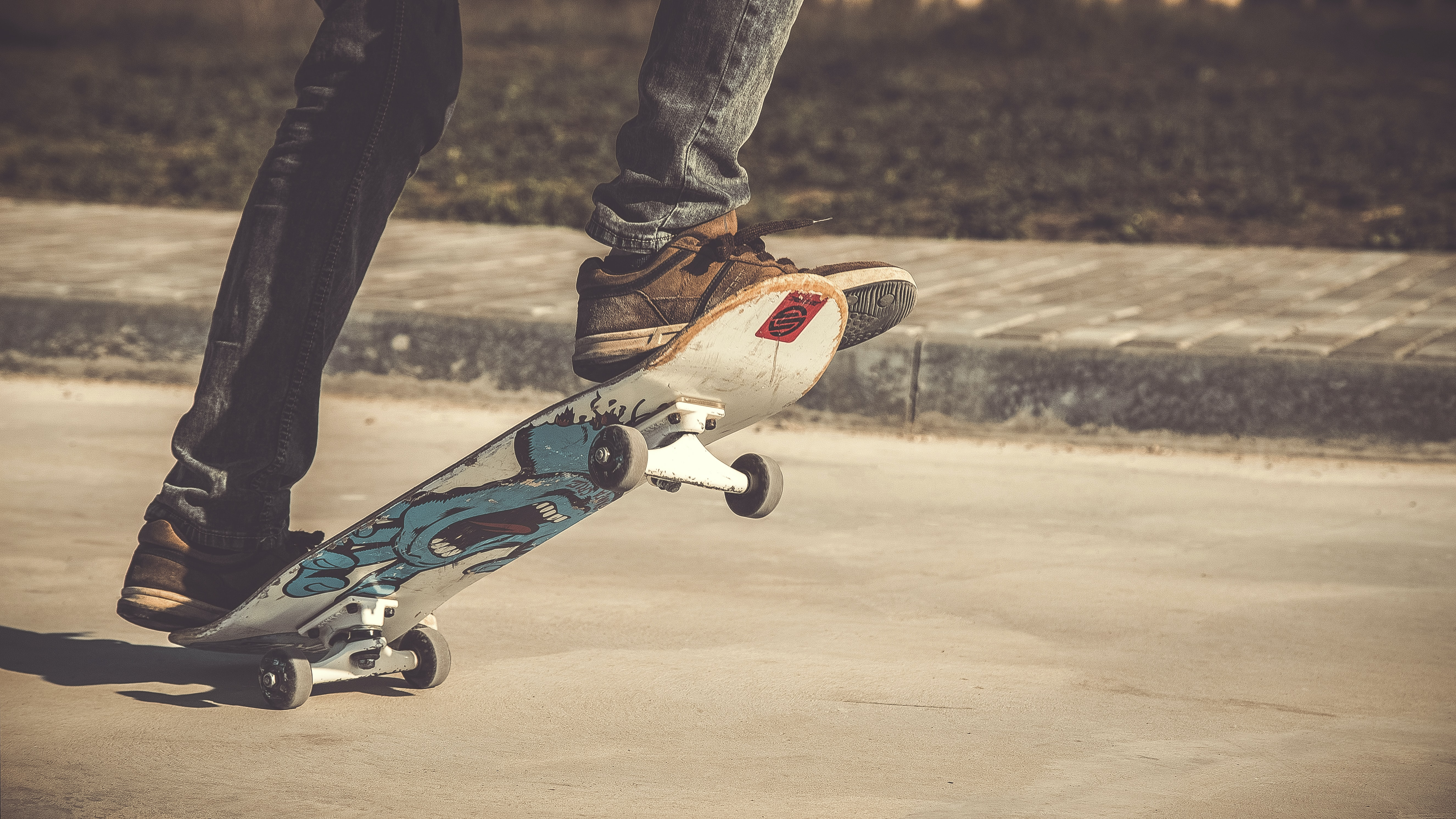 Cropped shot of a skateboarder's feet.