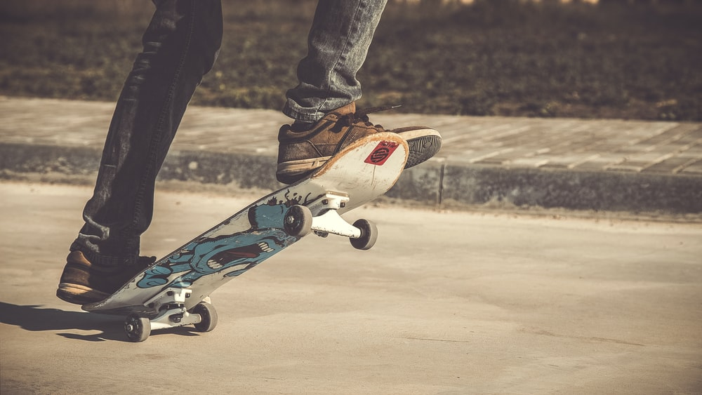 person riding skateboard during daytime