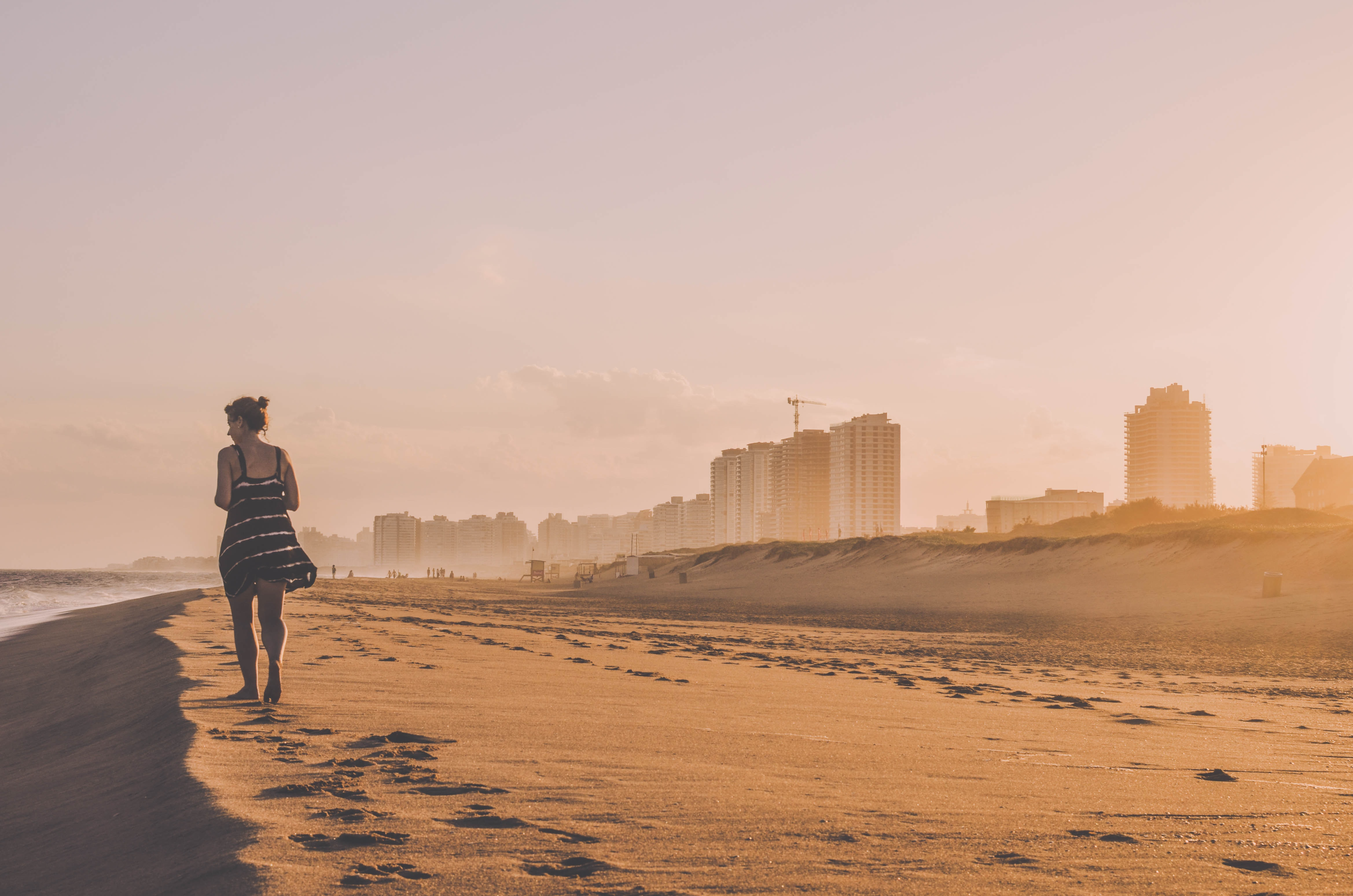 woman walking on desert sand