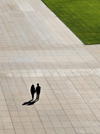 aerial photo of man and woman walking