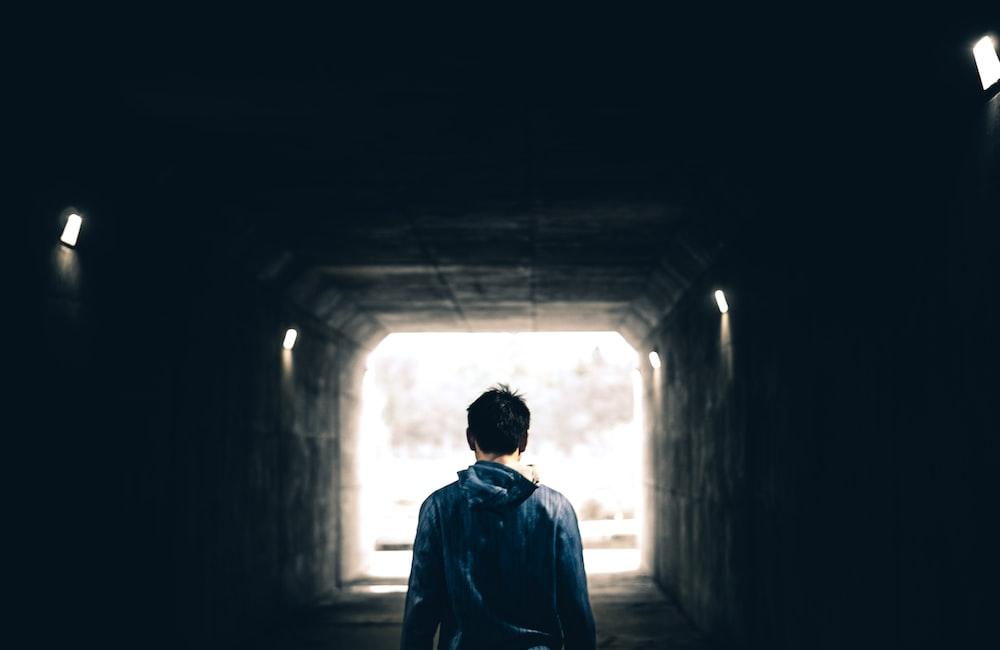 man standing in subway