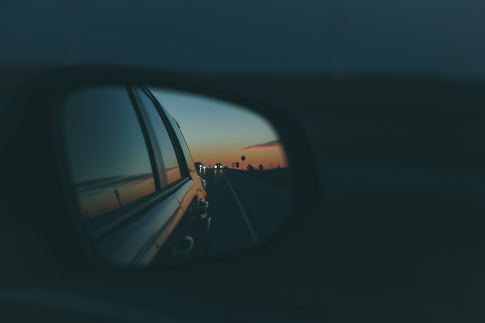 shallow focus photo of car side mirror