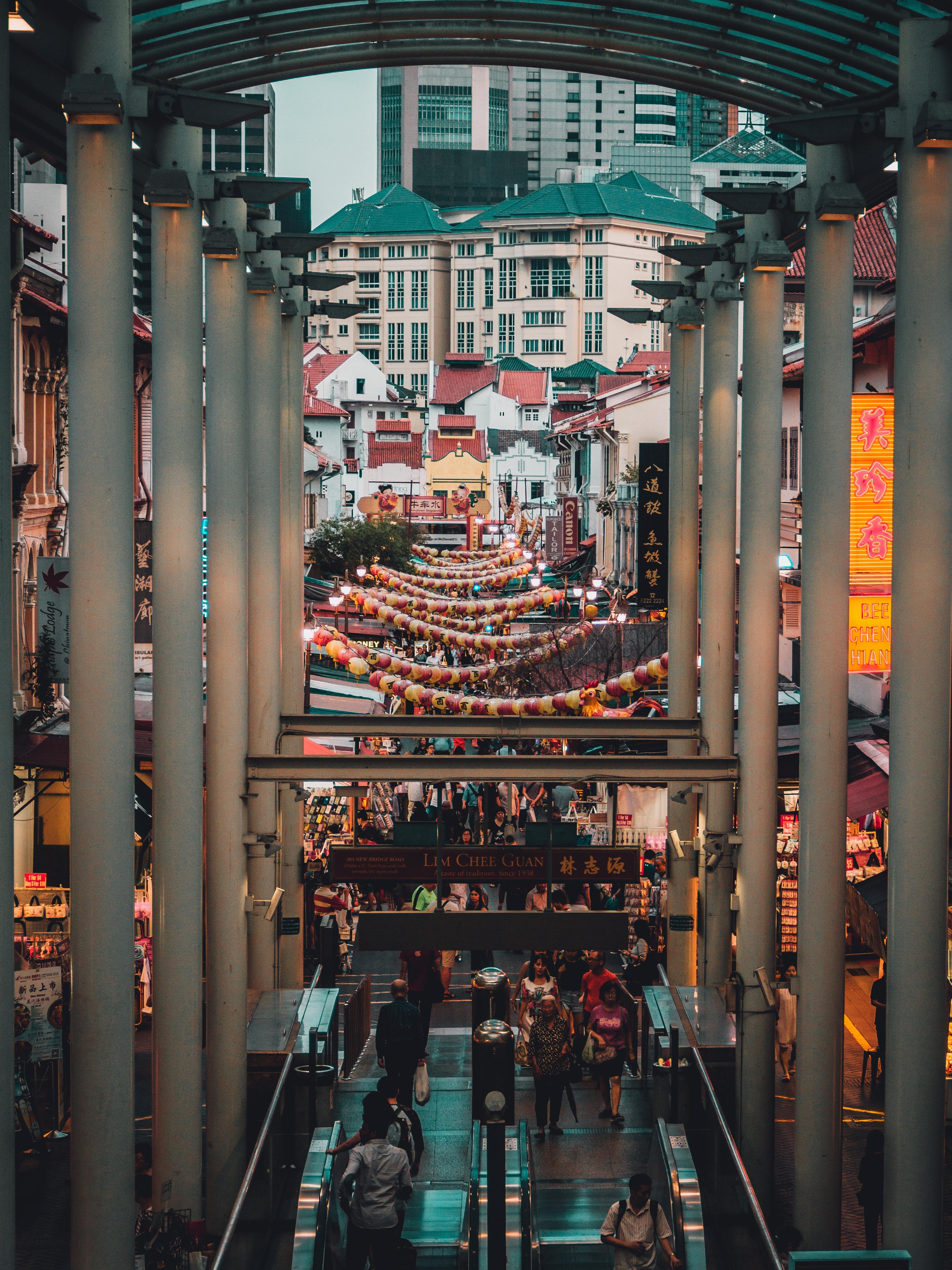 An escalator leading to a market street in Chinatown