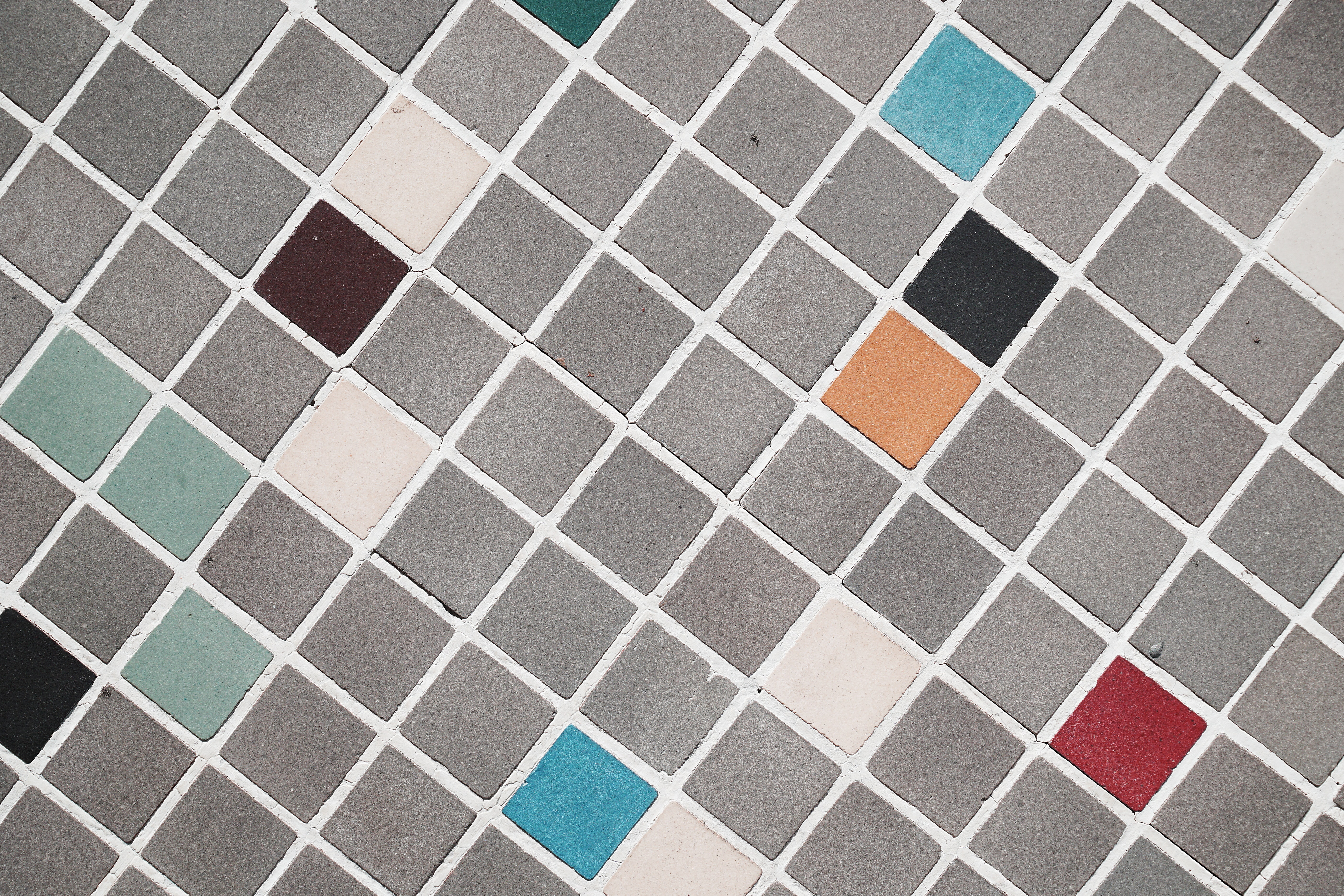 photo of gray, red, blue, and orange ceramic tiles