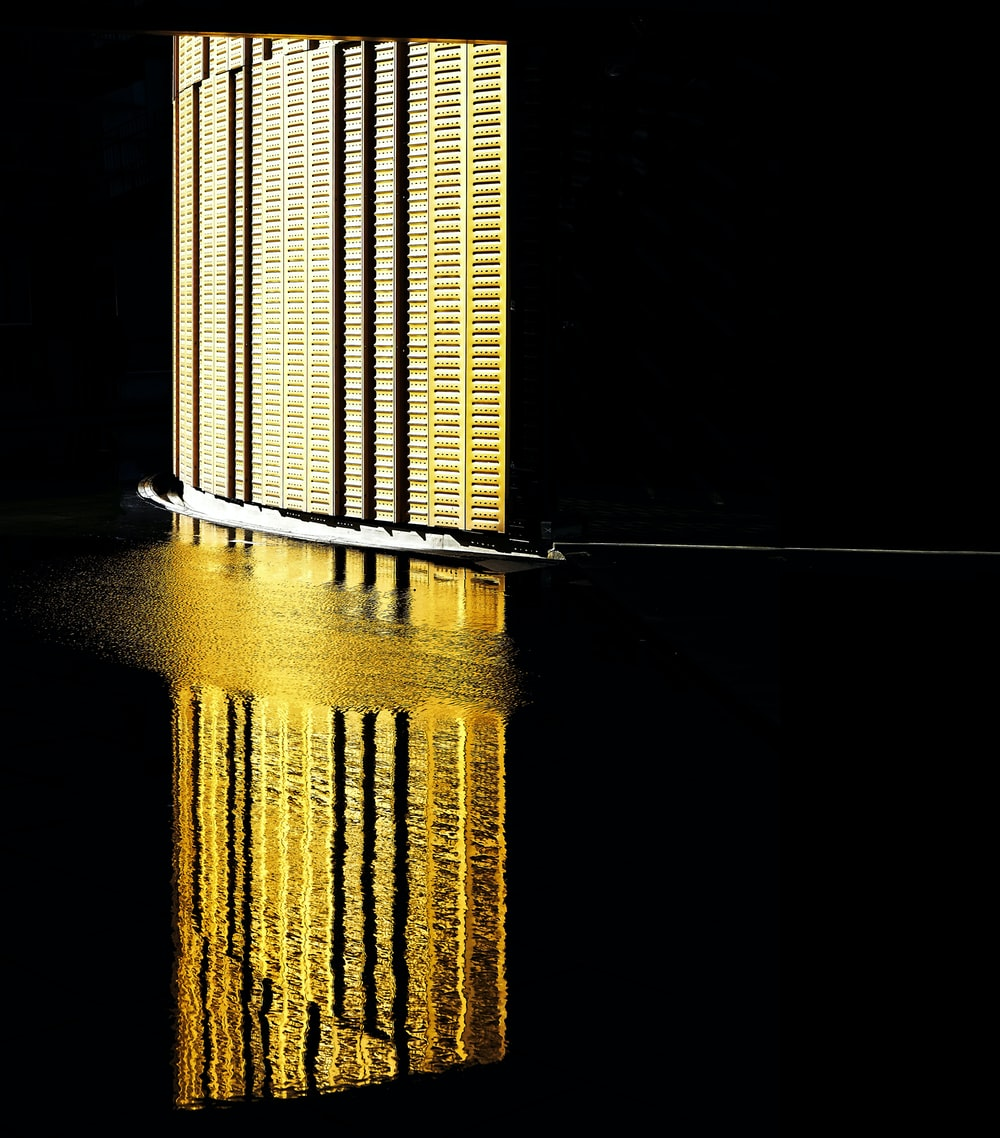The reflection of a brightly lit wall on the water surface at Fiera Milano Rho P5.