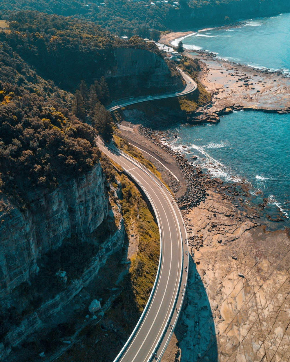 birds eye view of highway beside bay