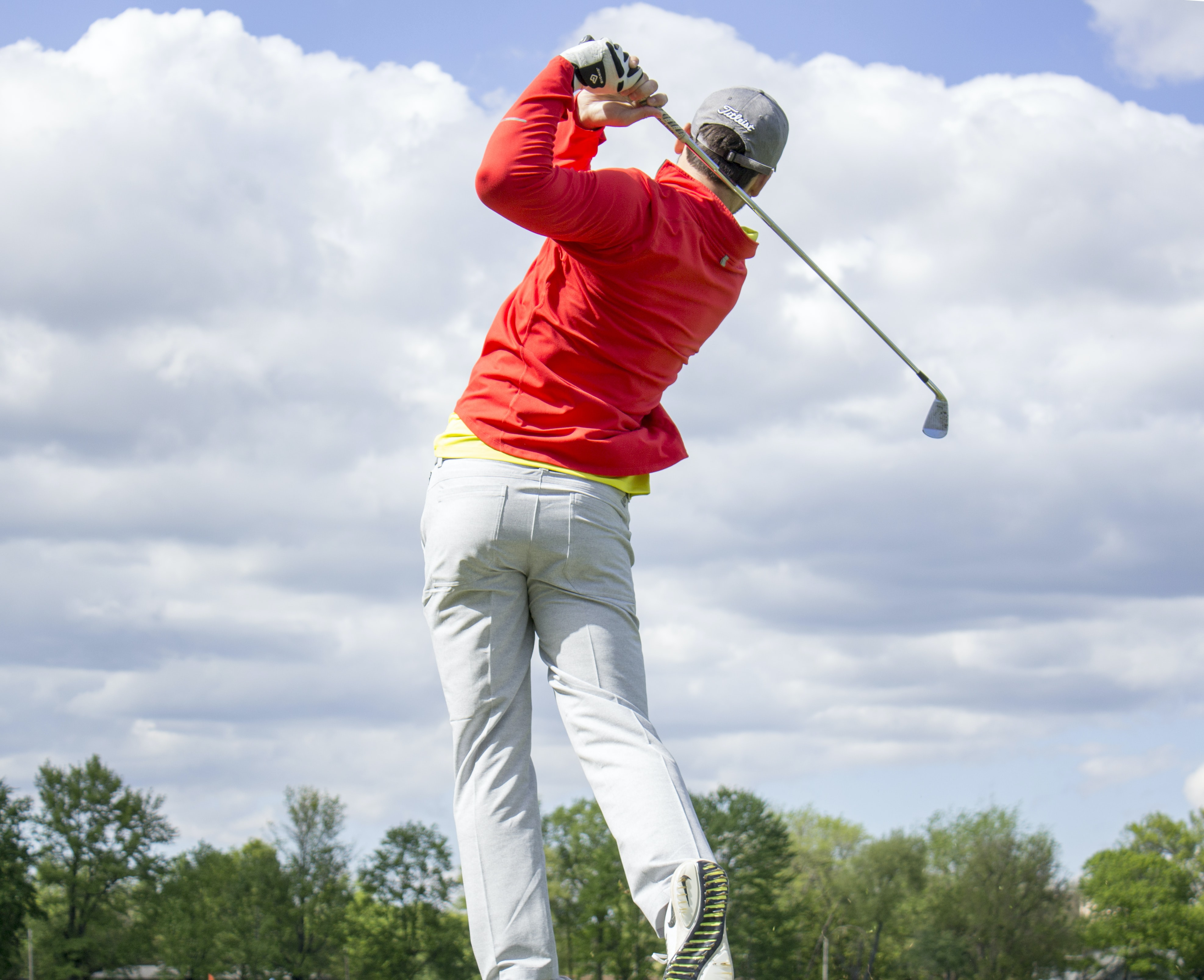man in red long-sleeved top golf