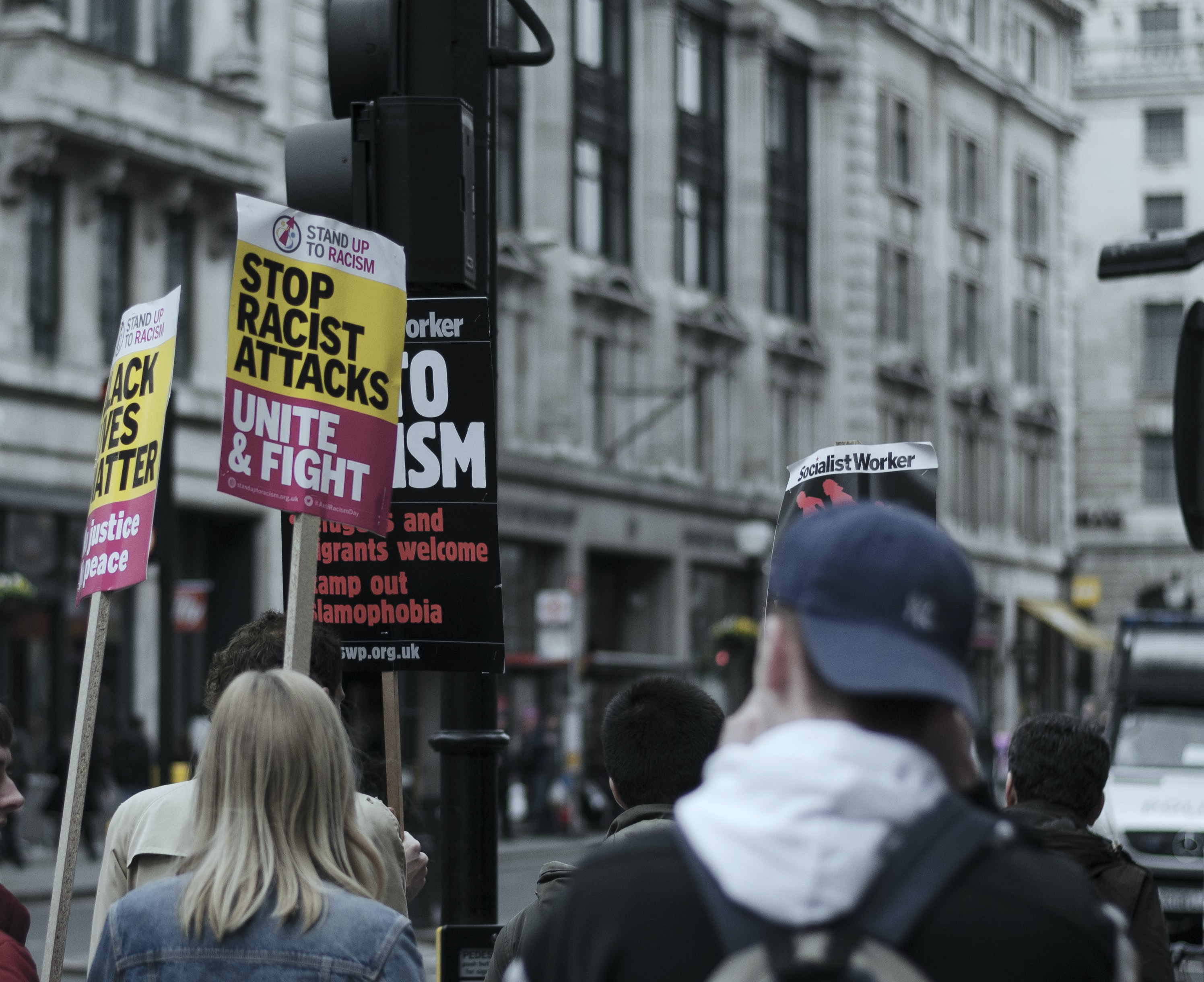 People with protest signs in Oxford Street, London