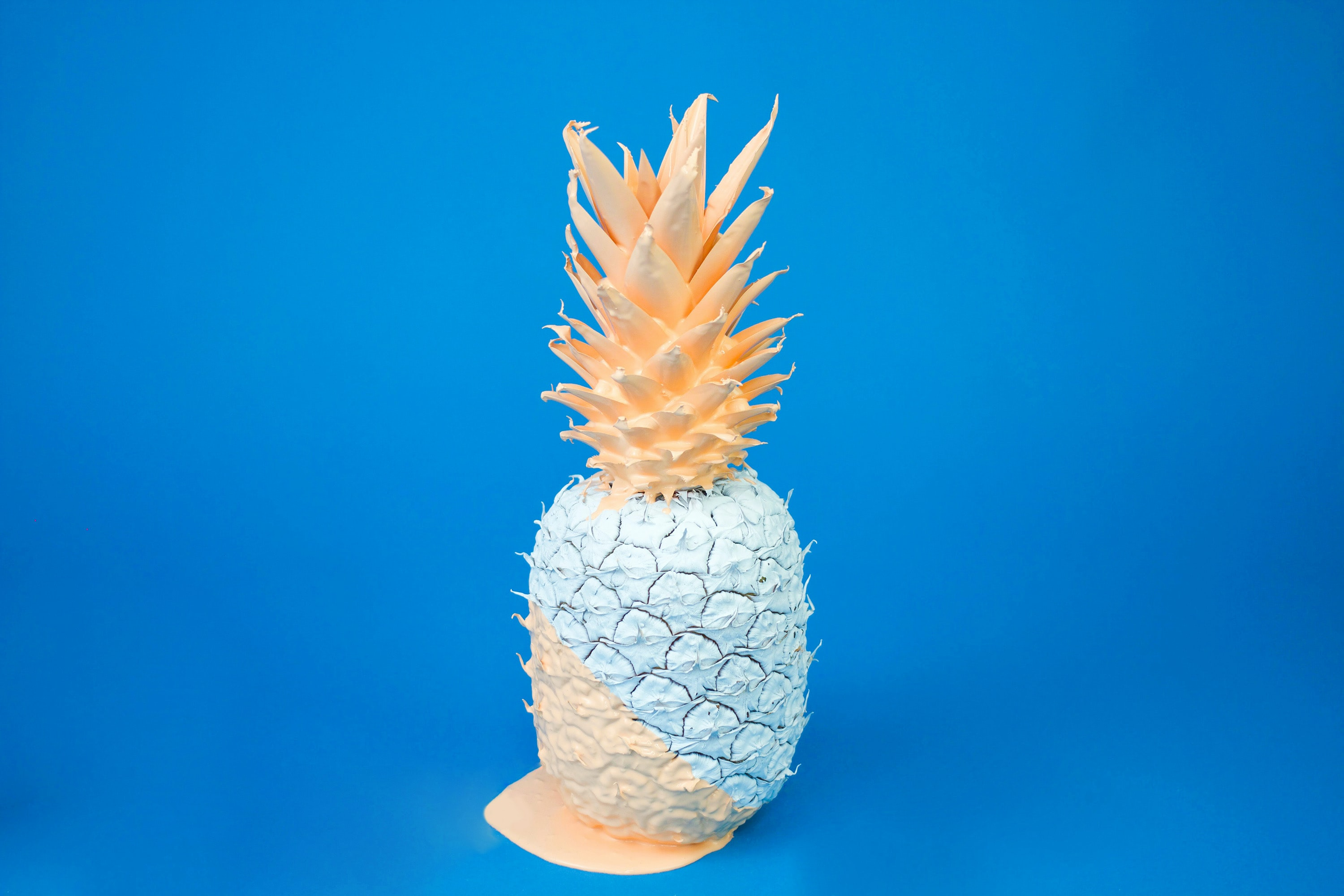 A pineapple covered in duotone paint.
