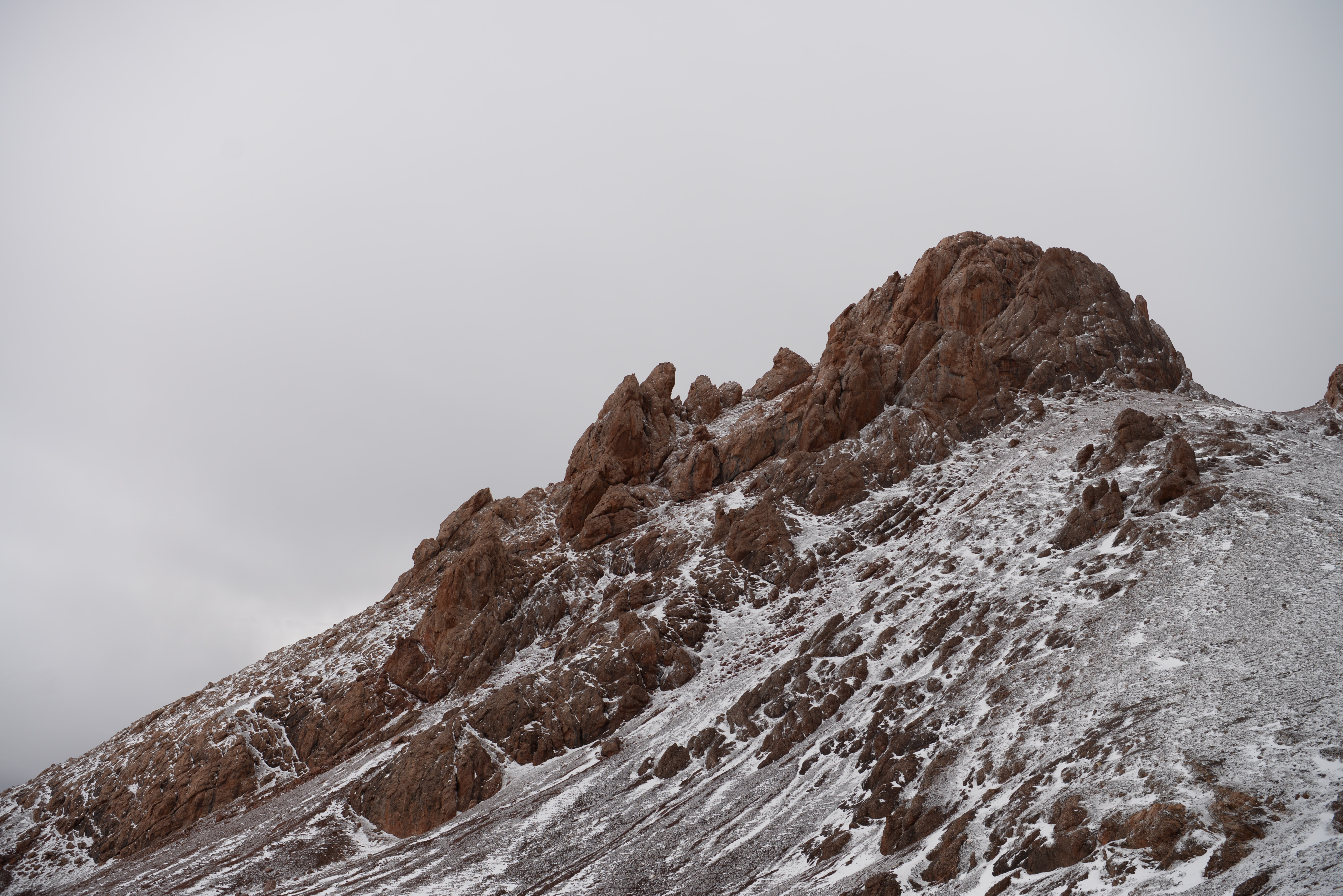 A rugged mountain peak in Tibet