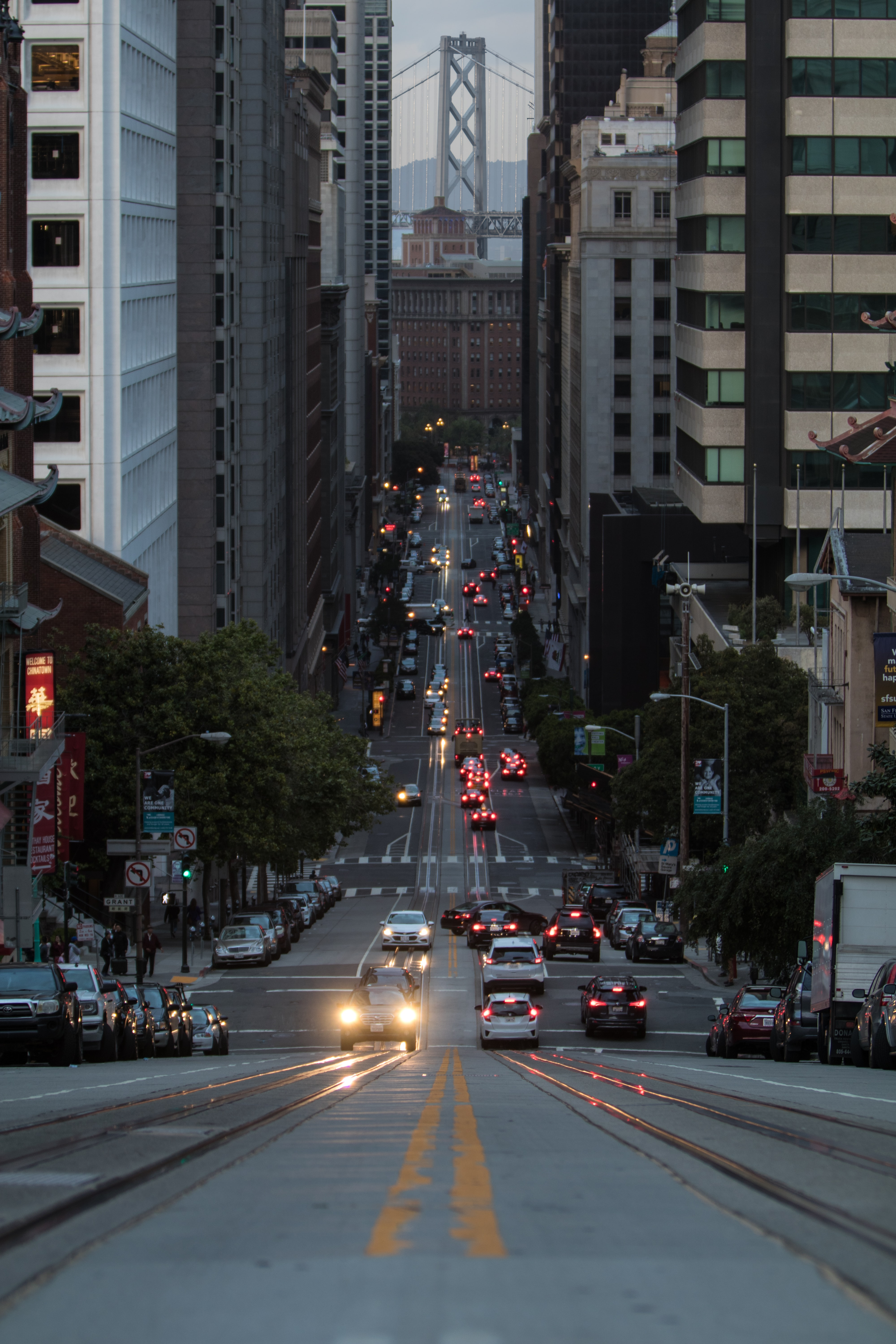 A sloping street in San Francisco in the evening