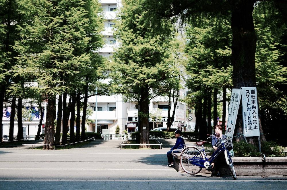 woman sitting on concrete block