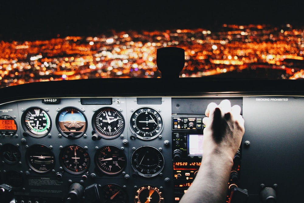 person holding airplane control panel
