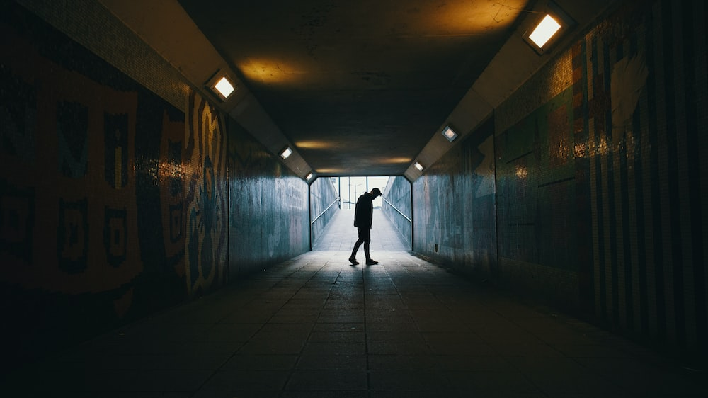 silhouette of a man inside subway