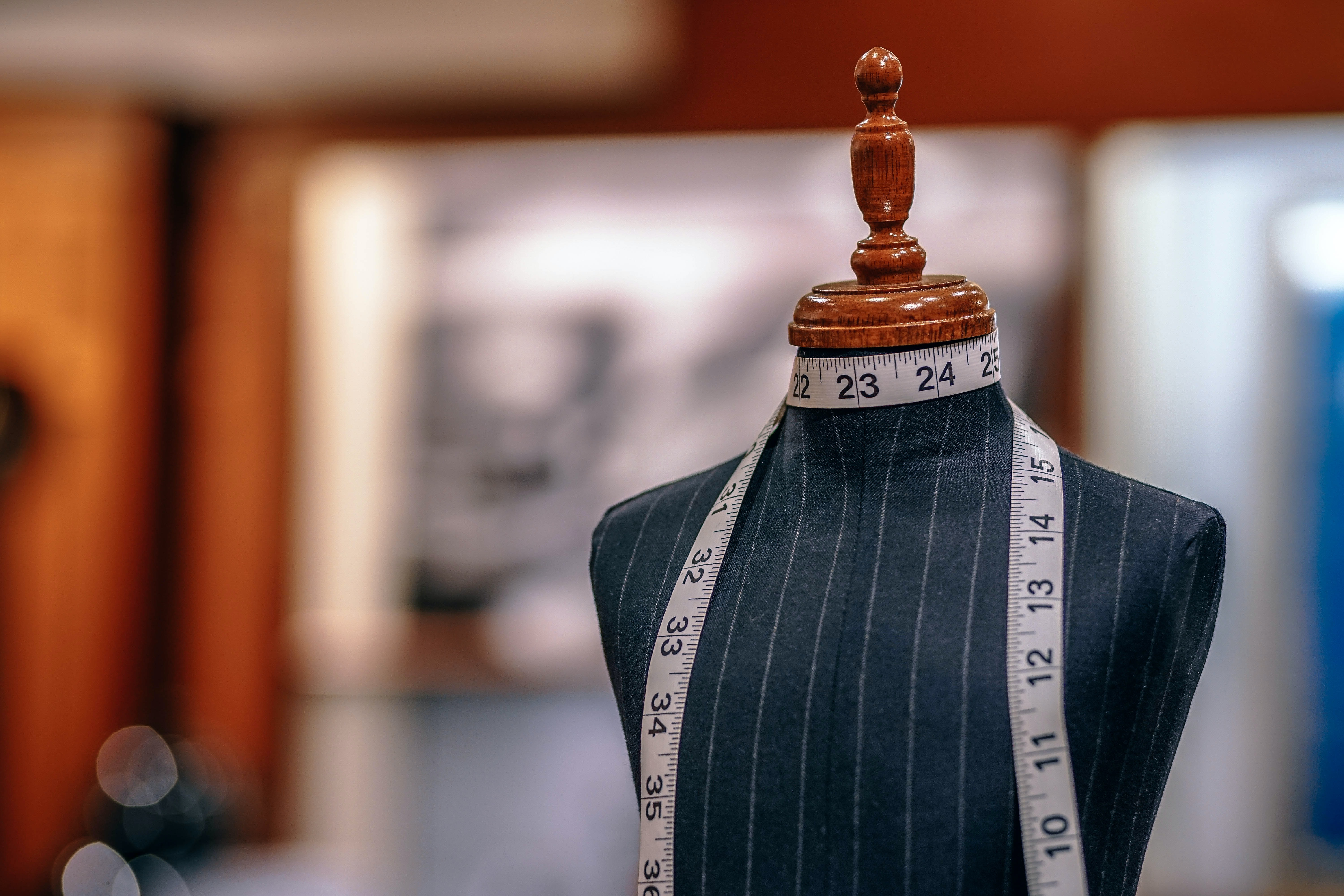 A mannequin with measuring tape wrapped around its neck