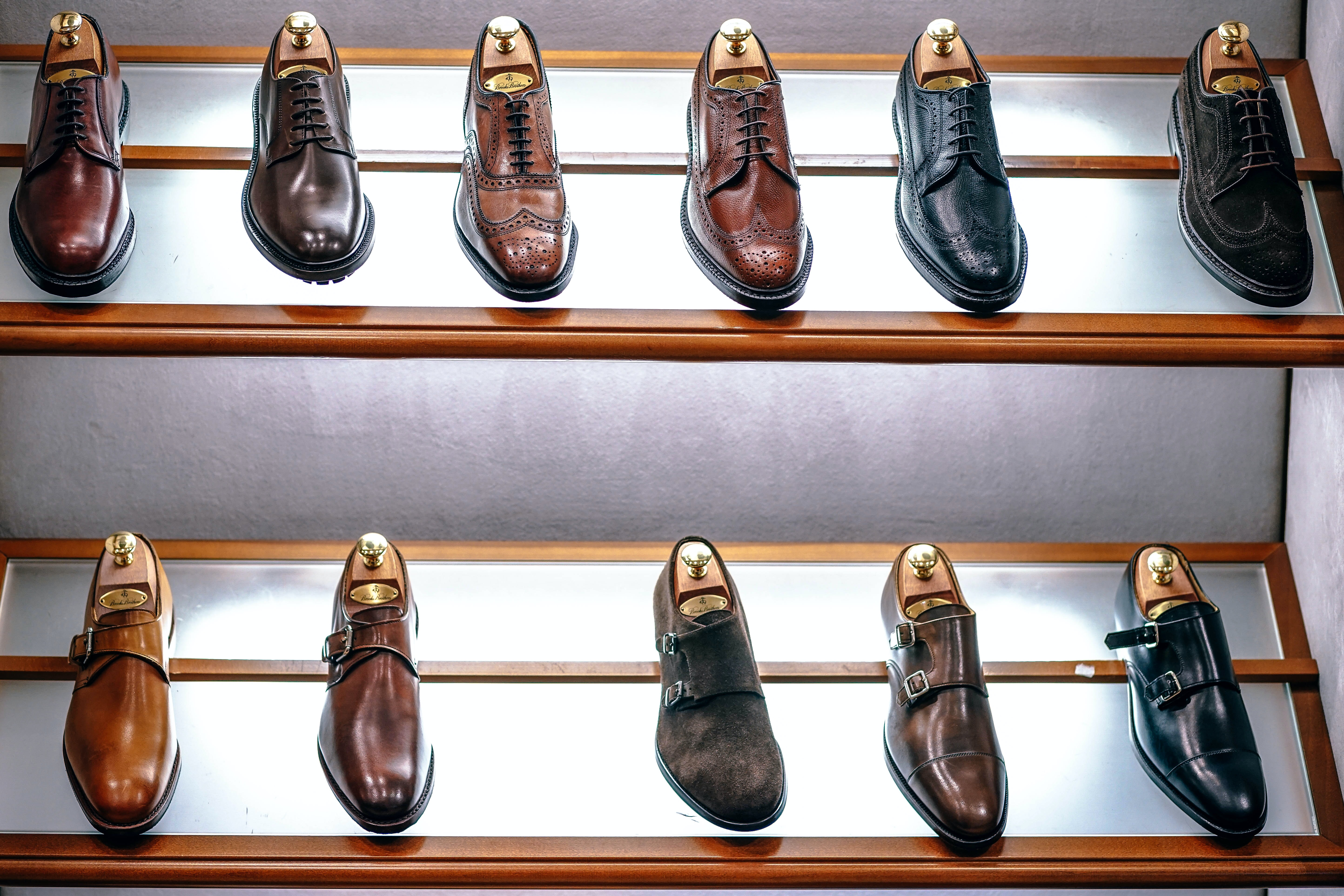 Shoes for men on display at a store.
