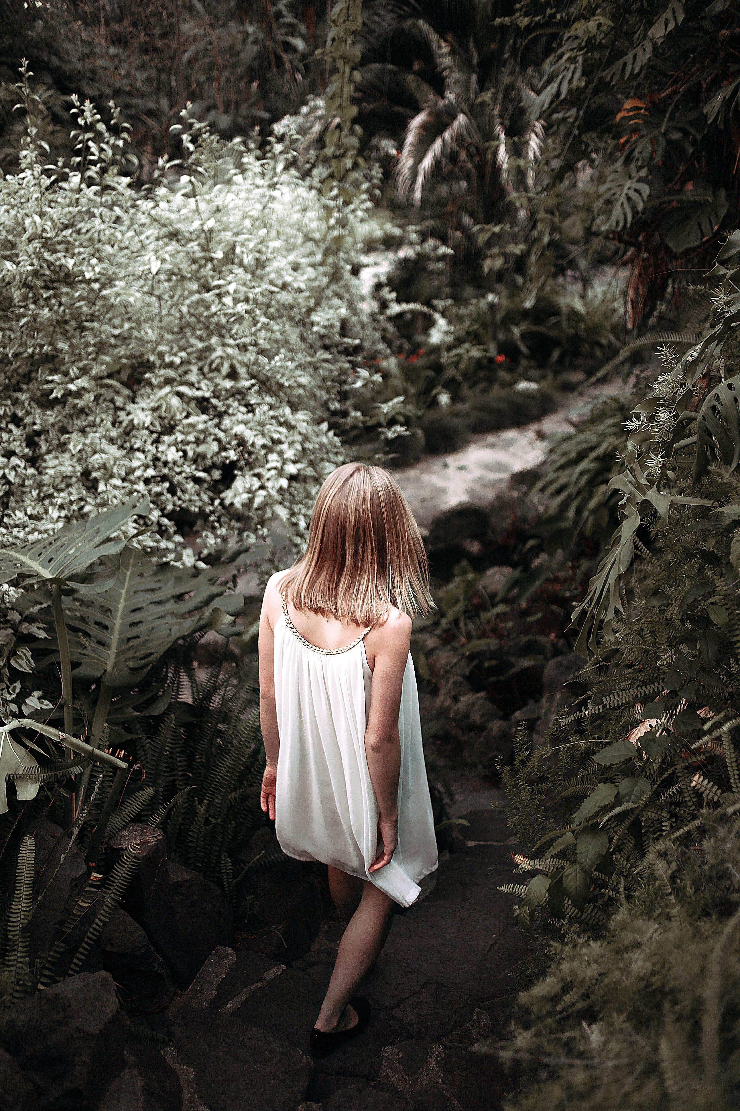 Girl exploring whimsical woods alone