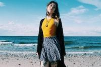 woman standing along seashore