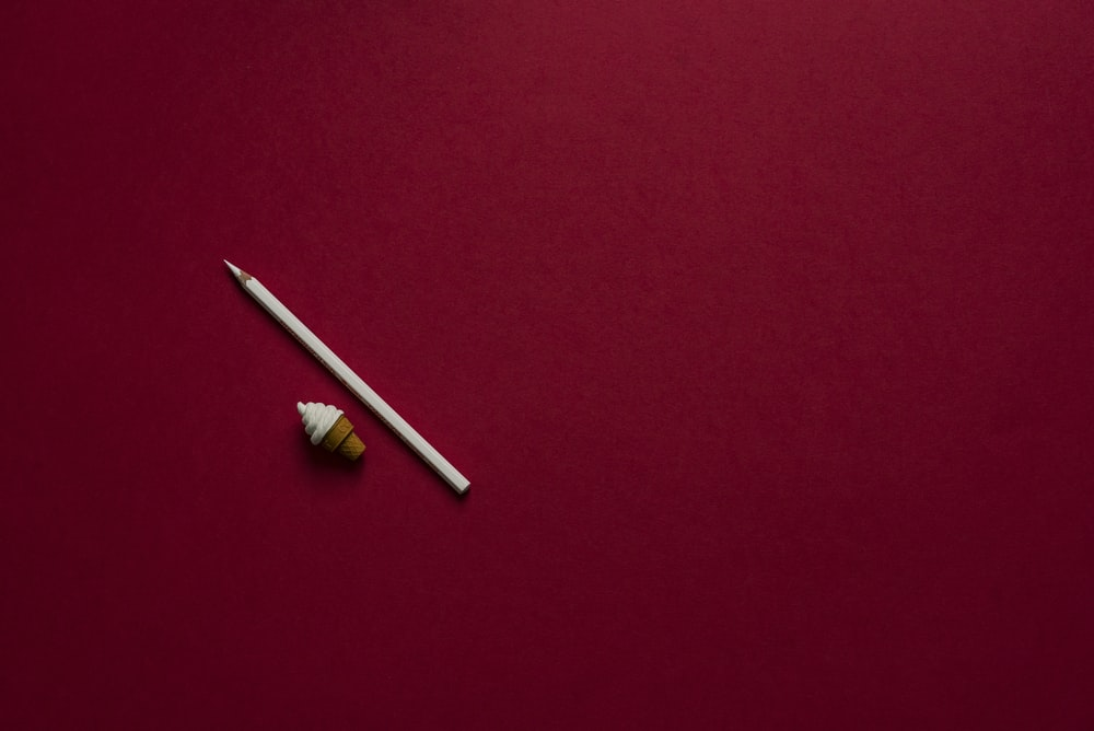 white pointed pencil