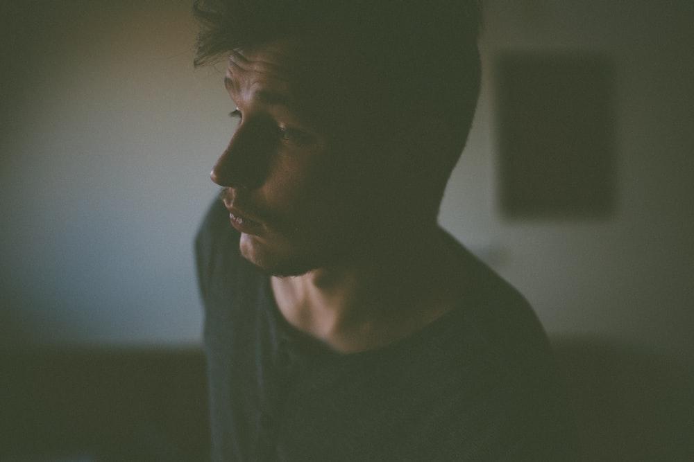 man in black shirt inside room