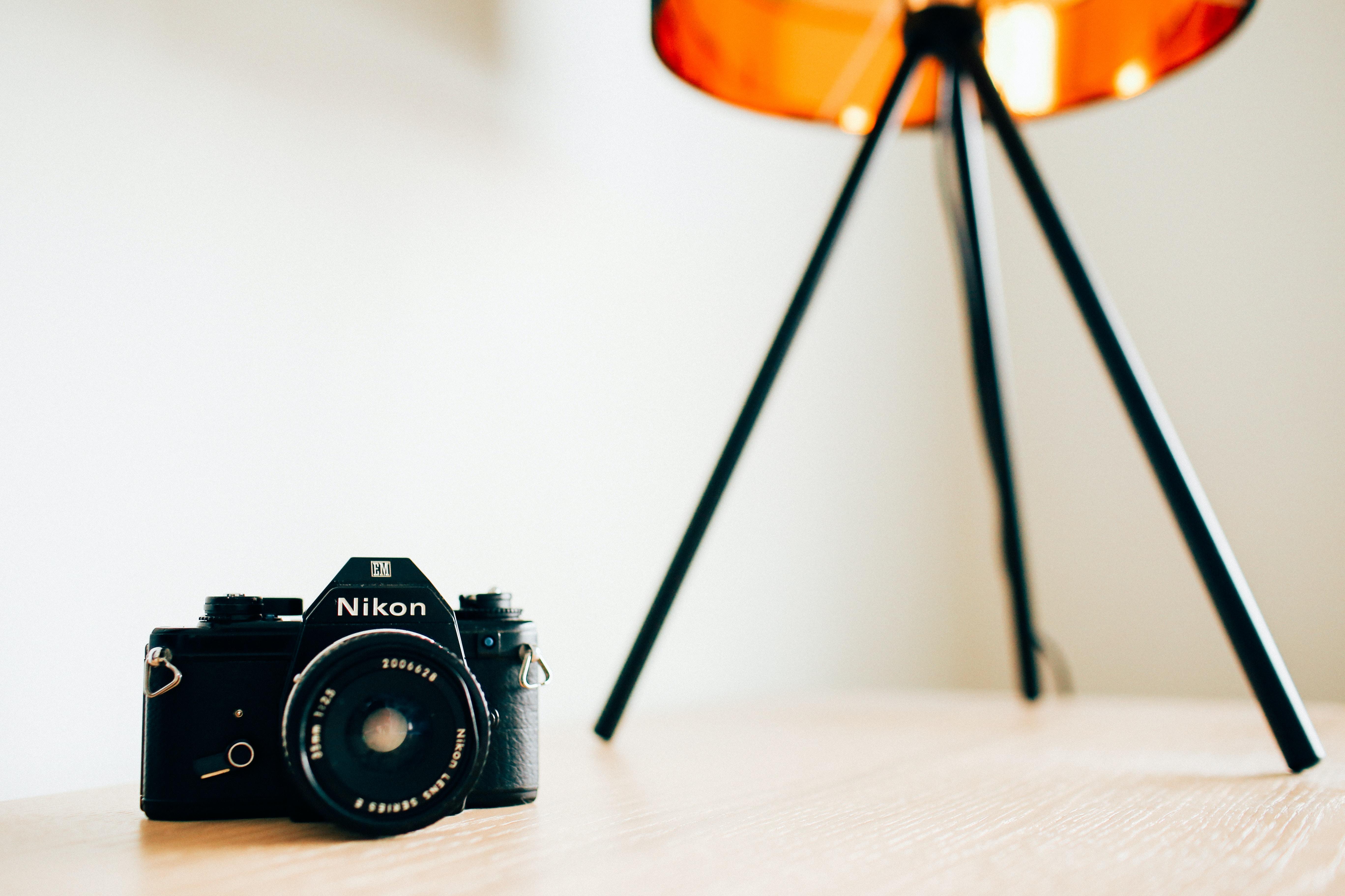 Nikon camera on a table with a tripod