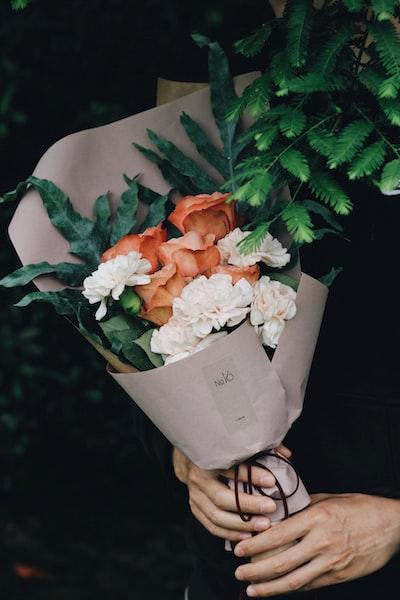 white and orange flower bouquet