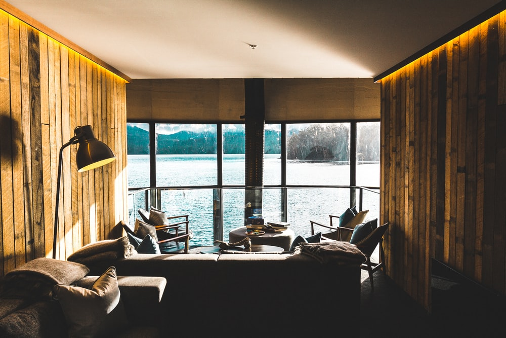 sofa and table inside room with body of water view