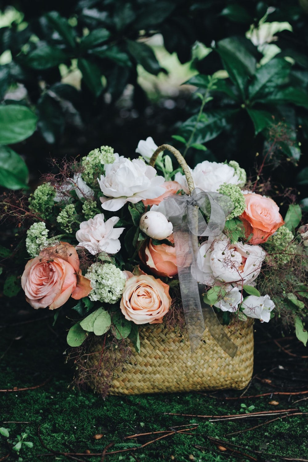 bouquet of white and pink flowers in basket