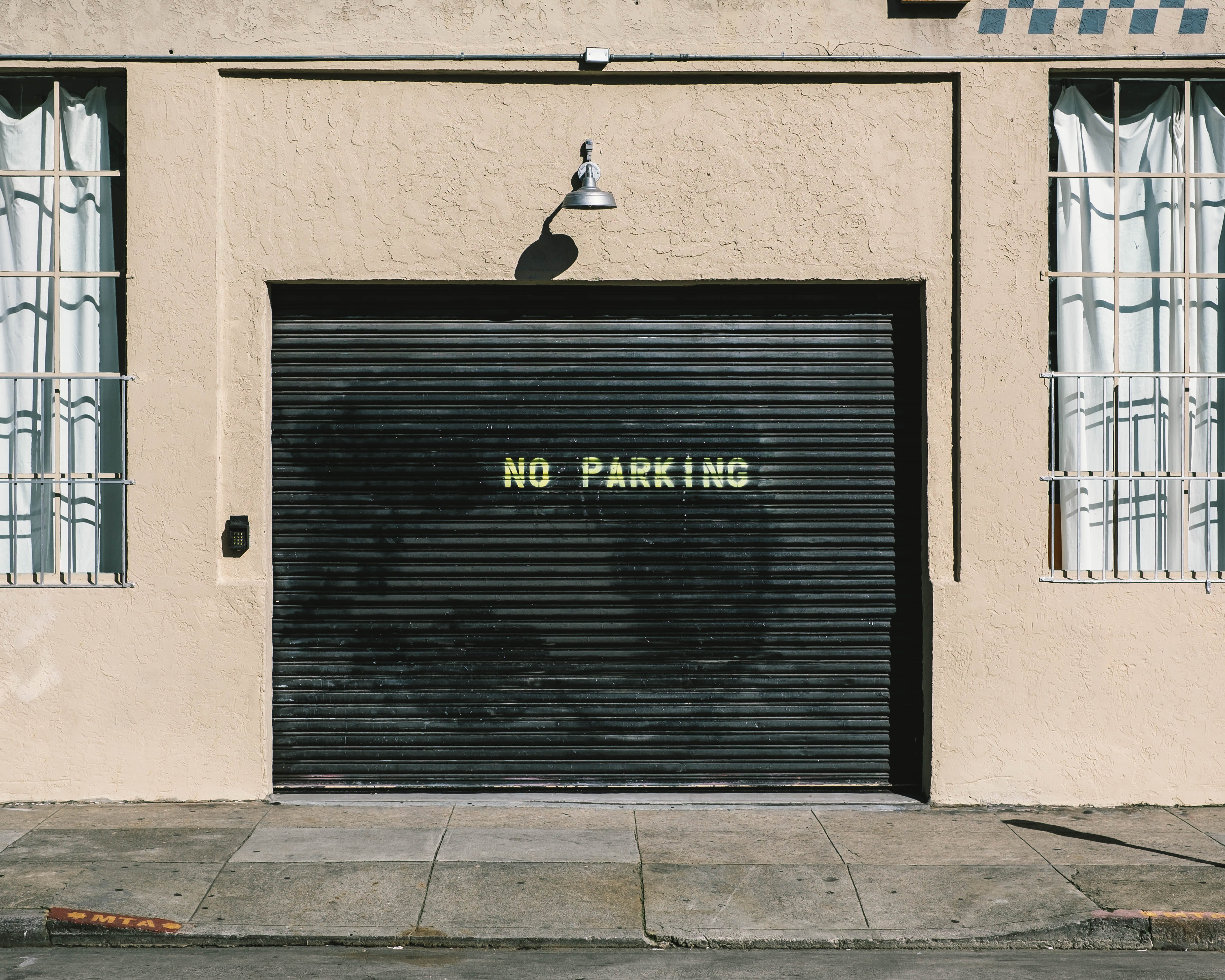 black metal roll-up door with no parking print