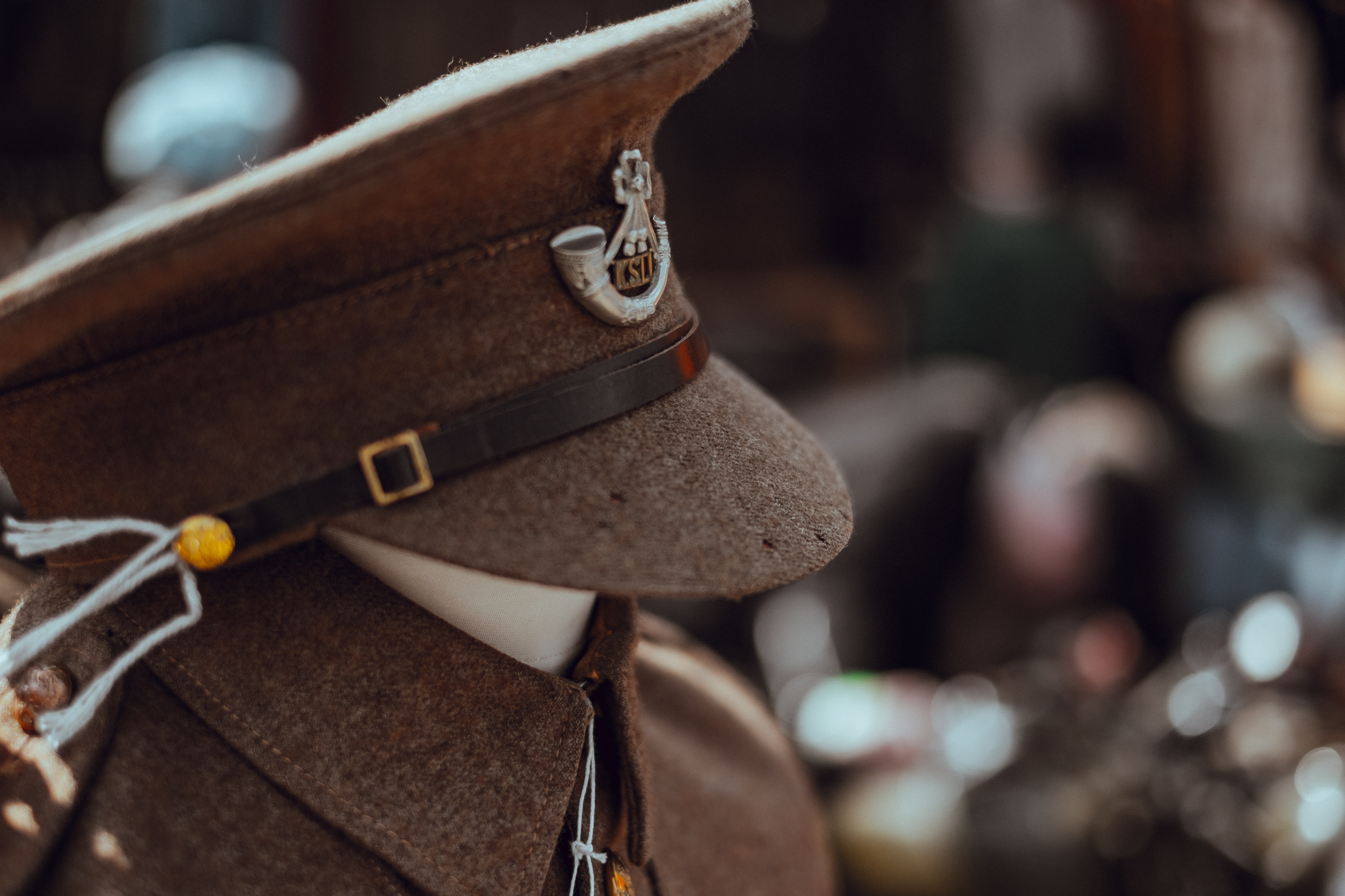 Macro of a ranking officer's hat on a manakin with a uniform