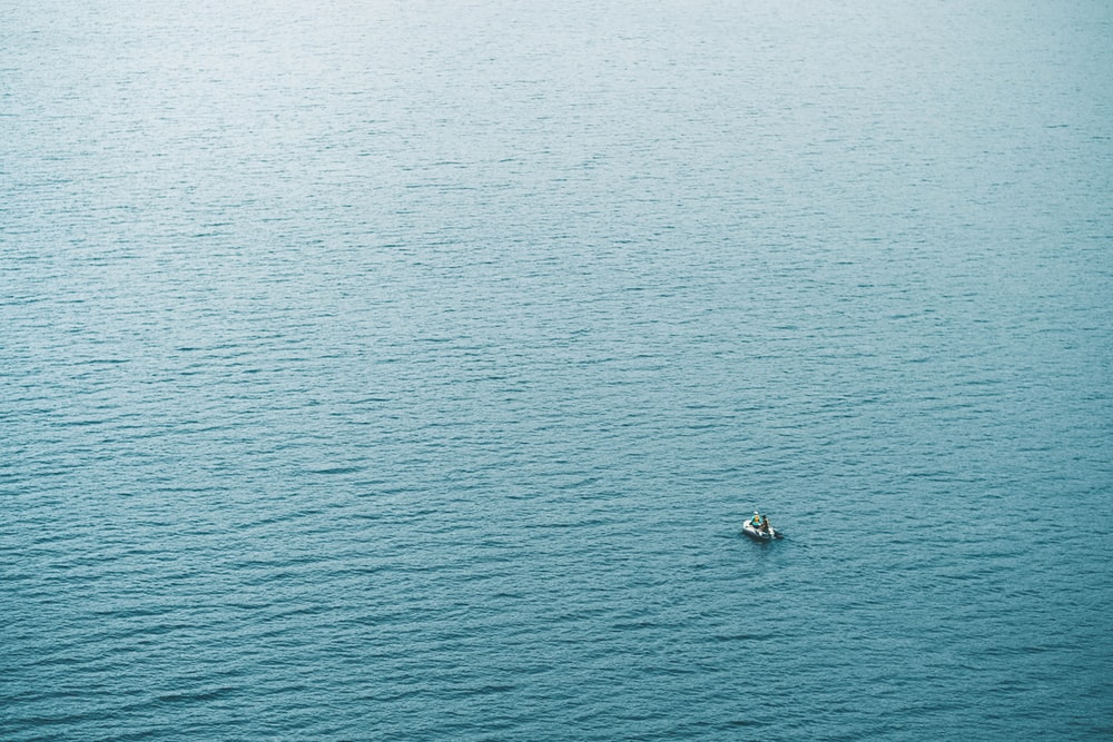 person in boat sailing at daytime