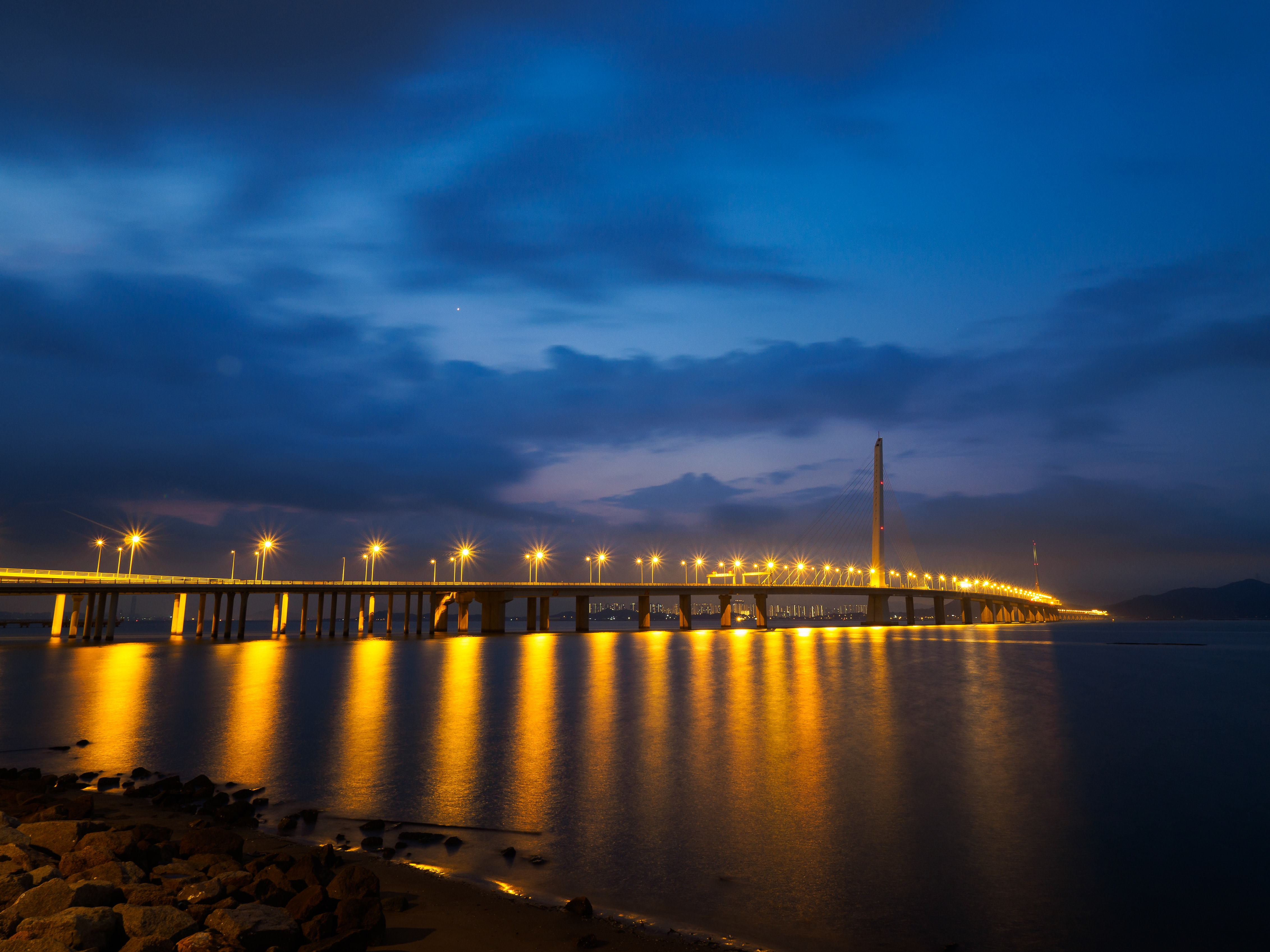 lighted sea bridge above water
