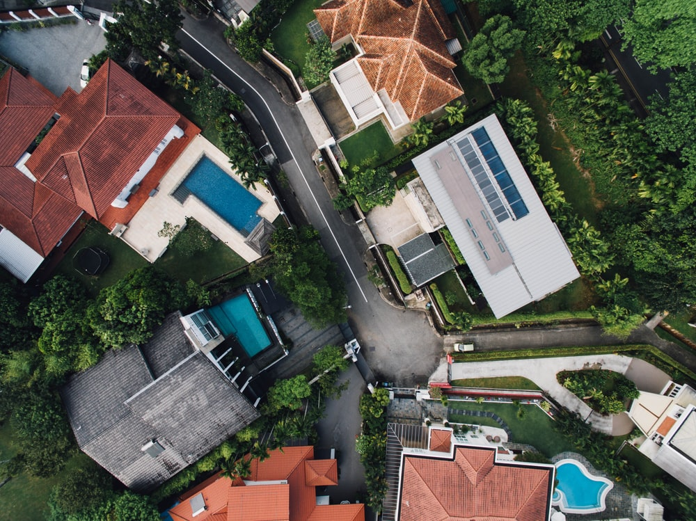 bird's eye view photo of concrete houses and street