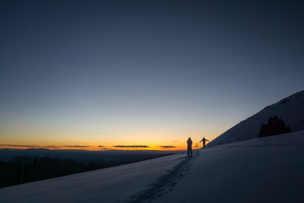 person standing on snowfield during daytime