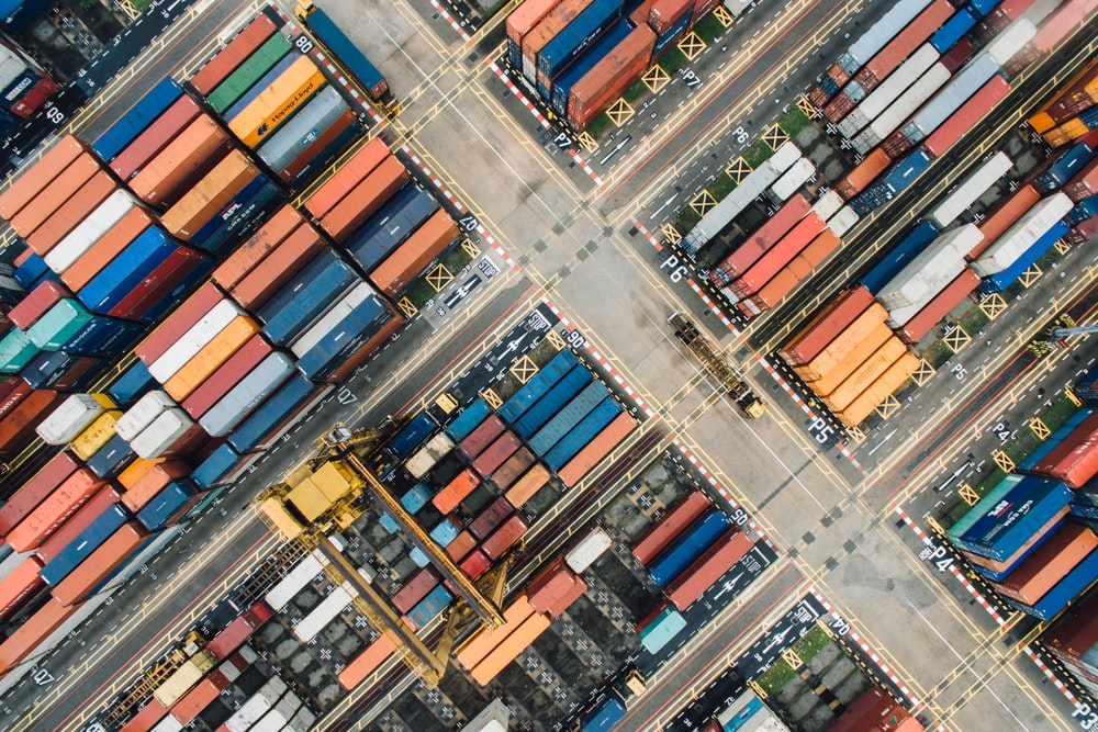 A drone shot of colorful shipping containers in a shipping terminal