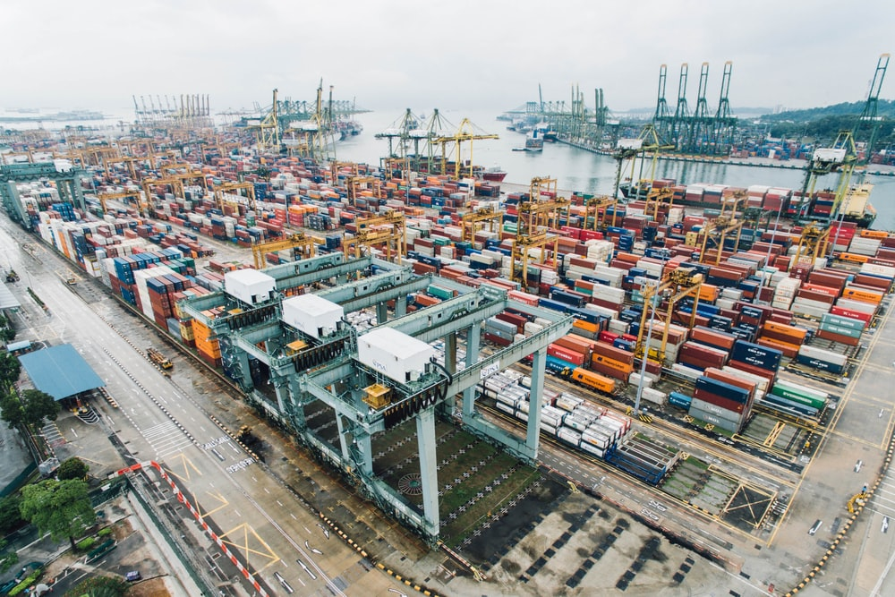 A drone shot of a busy port with a large number of cargo containers