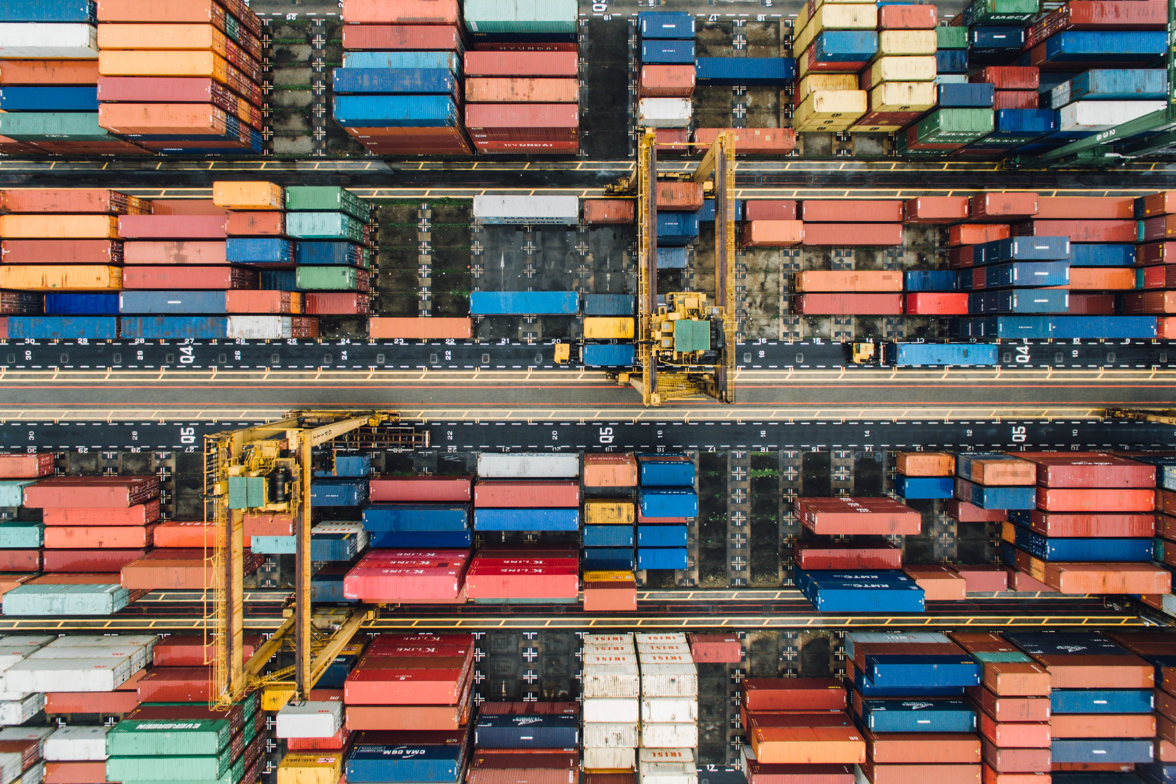A drone shot of colorful shipping containers in a terminal in Singapore