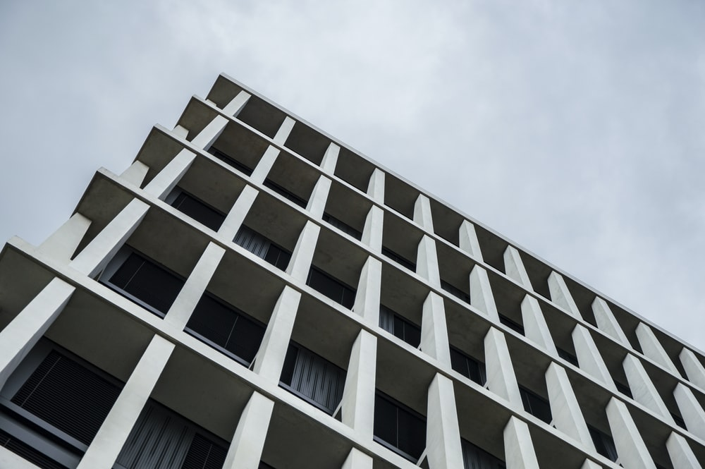 worm's eye view of white concrete building