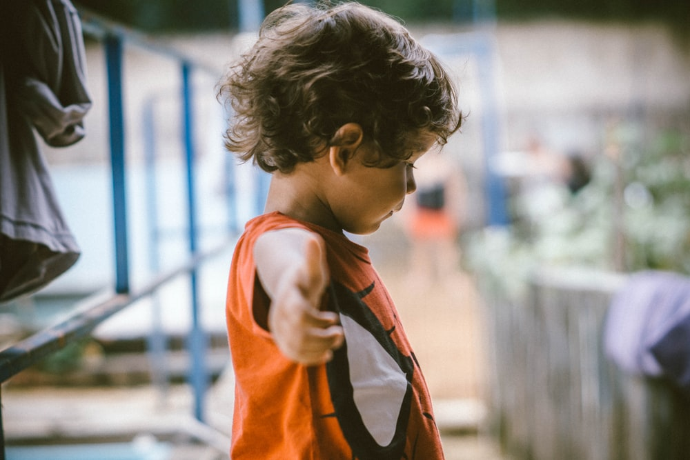 kid wearing deadpool shirt